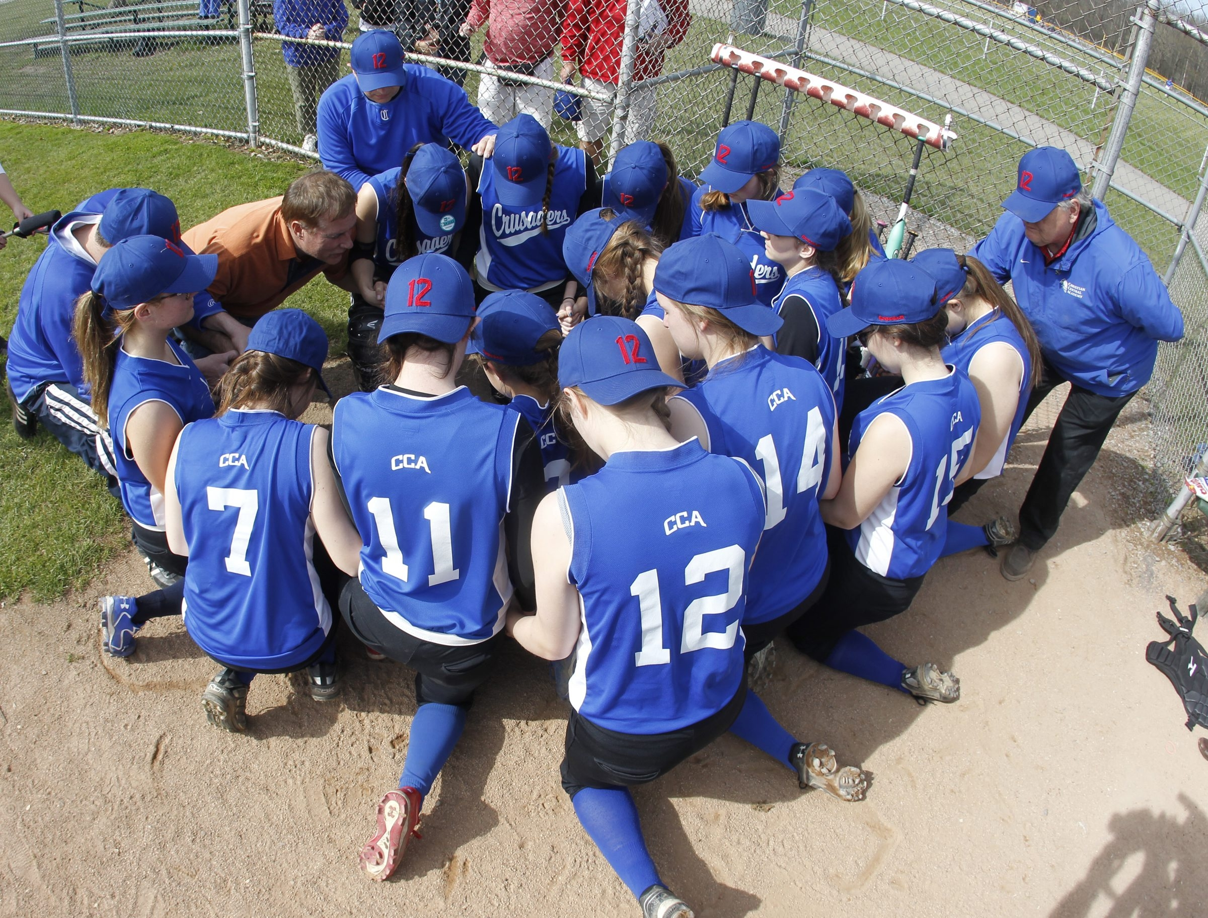 Dan Kelly, Brother of Buffalo Bills Hall of Fame quarterback Jim, prays over the Christian Central softball team on, Wednesday, May 7, 2014.The Christian Central baseball and softball team  will wear special hats in honor of Jim Kelly and his cancer fight. (Photo by Harry Scull Jr. /Buffalo News)