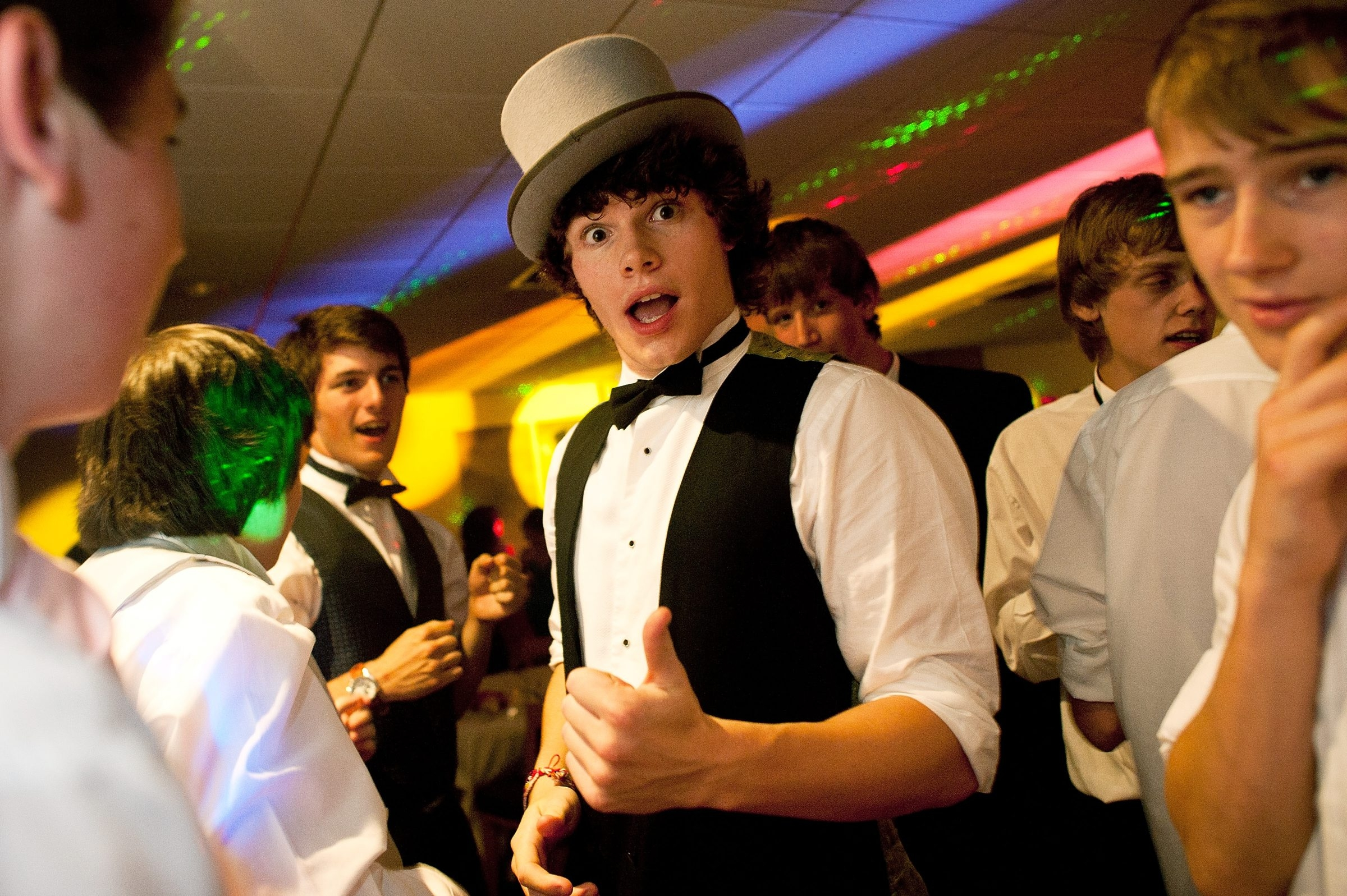 NEWCASTLE, UNITED KINGDOM – JULY 01:  Student James Pervis tries on a friends hat during the prom at St James' Park on July 1, 2011 in Newcastle, United Kingdom. After months of preparation more than 200 final year students aged 15 to 16 from Cramlington Learning Village attended a leaver's prom at St James Park, Newcastle. The prom marks the end of GCSE examinations and the completion of their high school studies.  (Photo by Bethany Clarke/Getty Images)