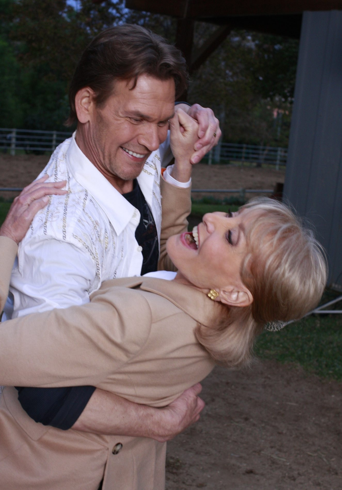 Barbara Walters, shown here with Patrick Swayze in 2009, signs off Friday.