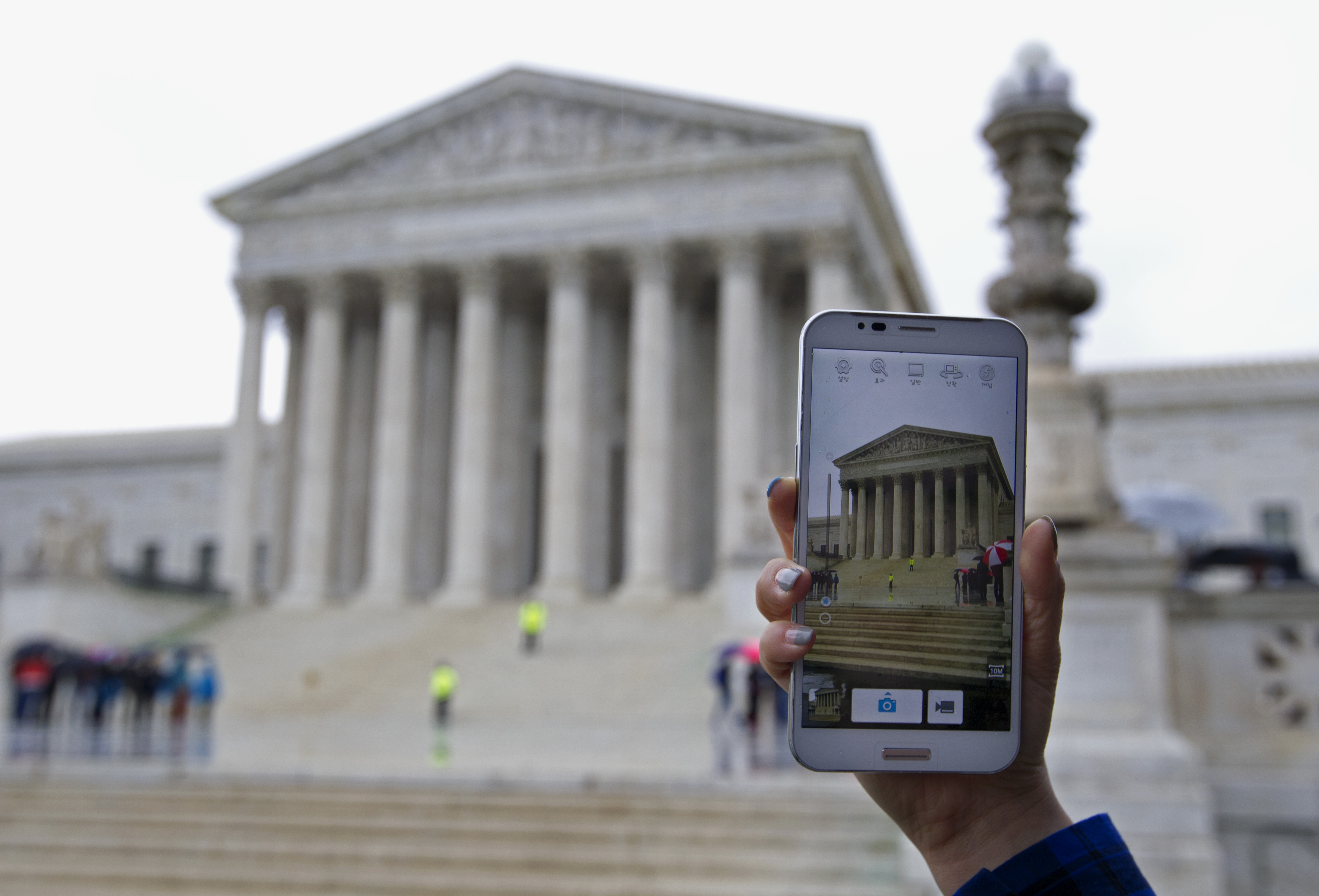 The Supreme Court is considering whether police may search cellphones found on people they arrest without first getting a warrant. ( Associated Press)