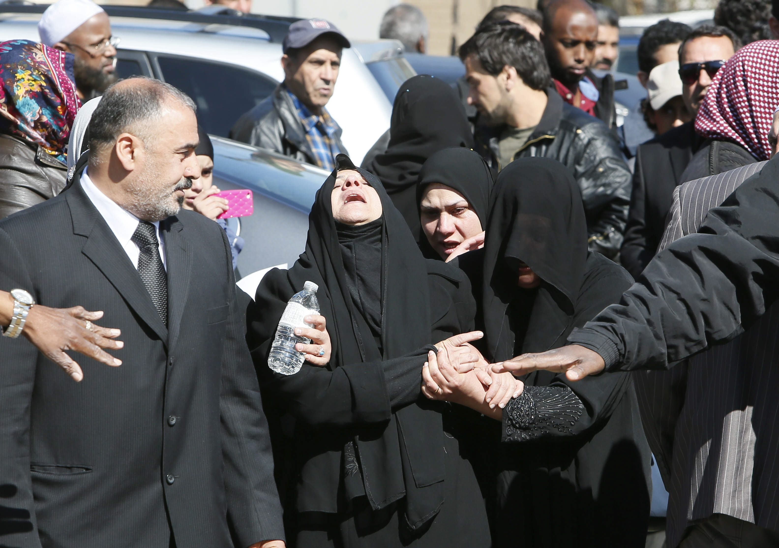Mourners leave the Masjid Al-Eman Mosque on Connecticut Street after the funeral of 13-year-old Ameer Al Shammari, Tuesday, May 6, 2014.   (Derek Gee/Buffalo News)