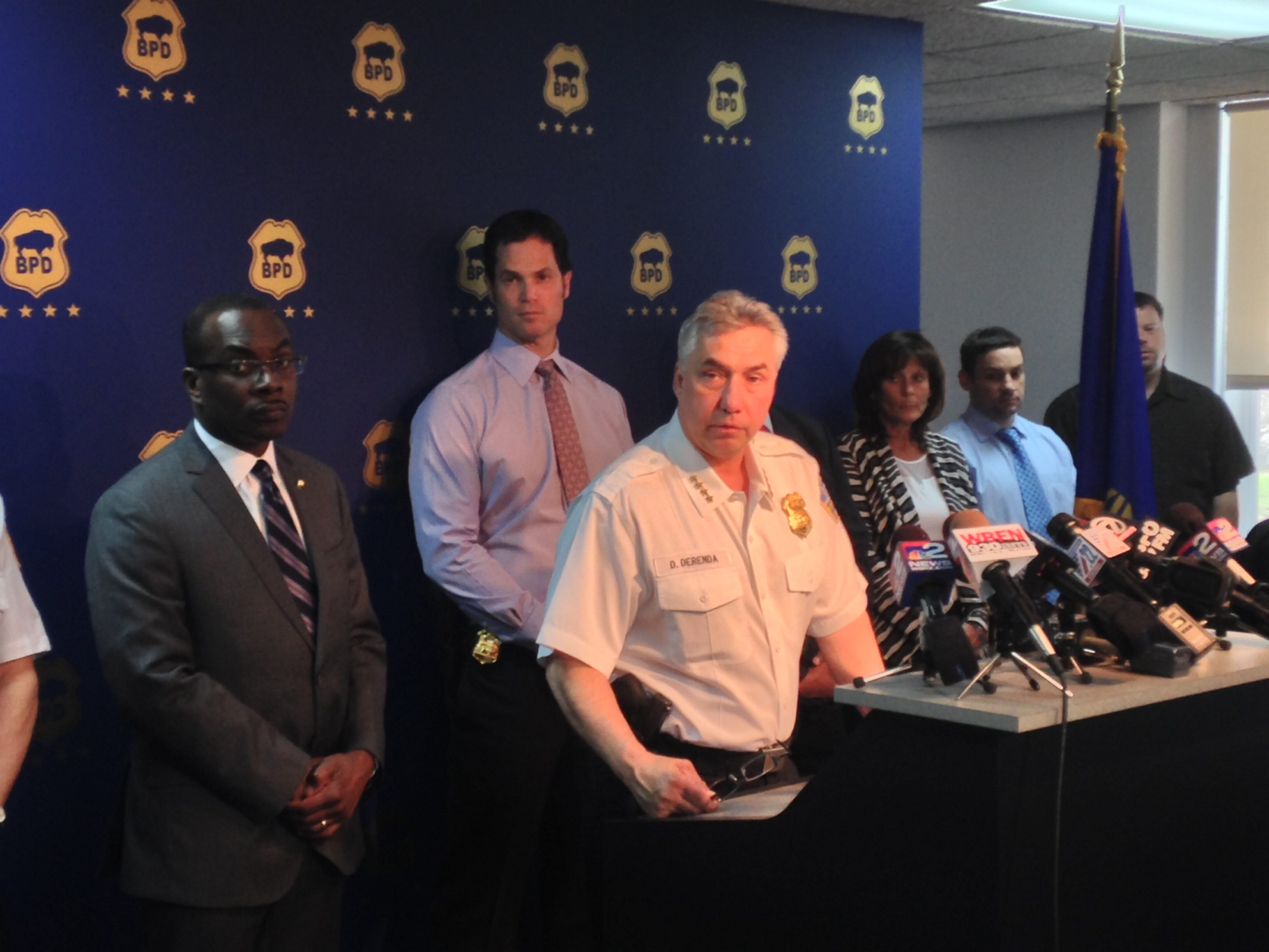 Mayor Byron W. Brown, left, and Police Commissioner Daniel Derenda address a news conference today.