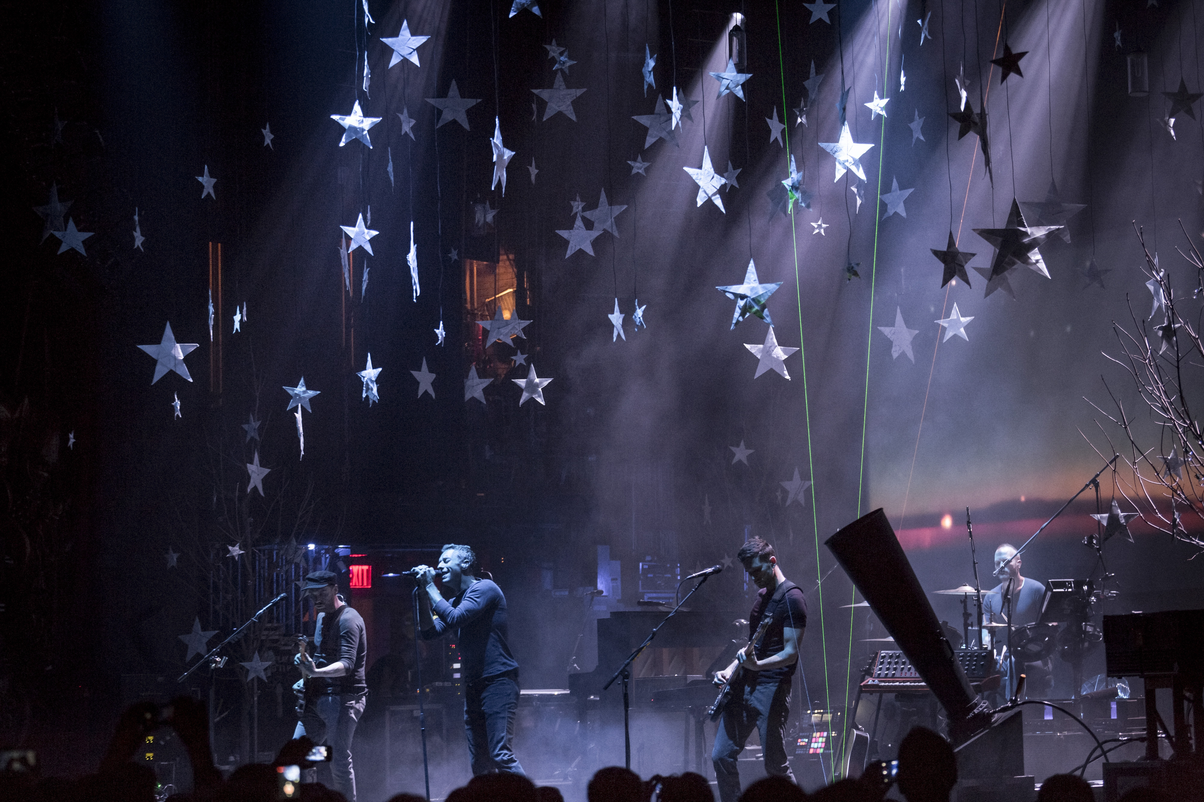 Jonny Buckland, Chris Martin, Guy Berryman and Will Champion of Coldplay perform in New York on Monday.