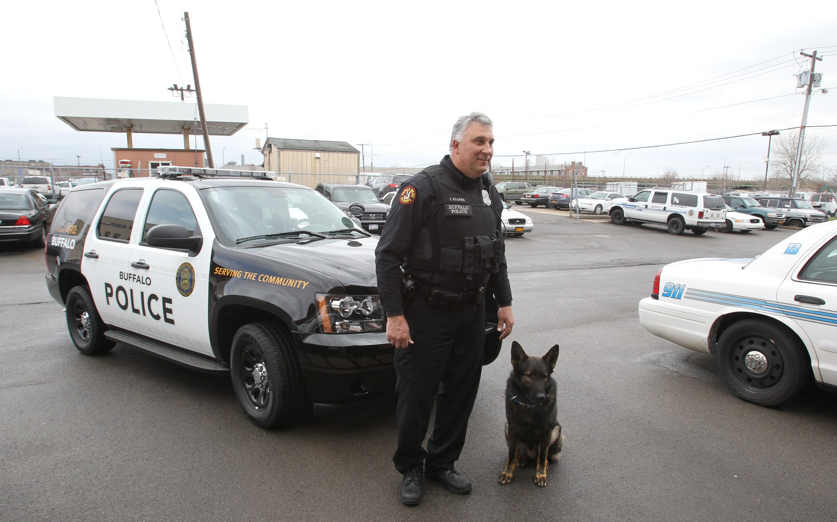 """Buffalo Police Officer John T. Kujawa, at 6-feet-6 and 275 pounds, says that the Tahoe is an ideal size for him and his K-9 partner Destro and that it has """"ample room to safely transport prisoners."""""""