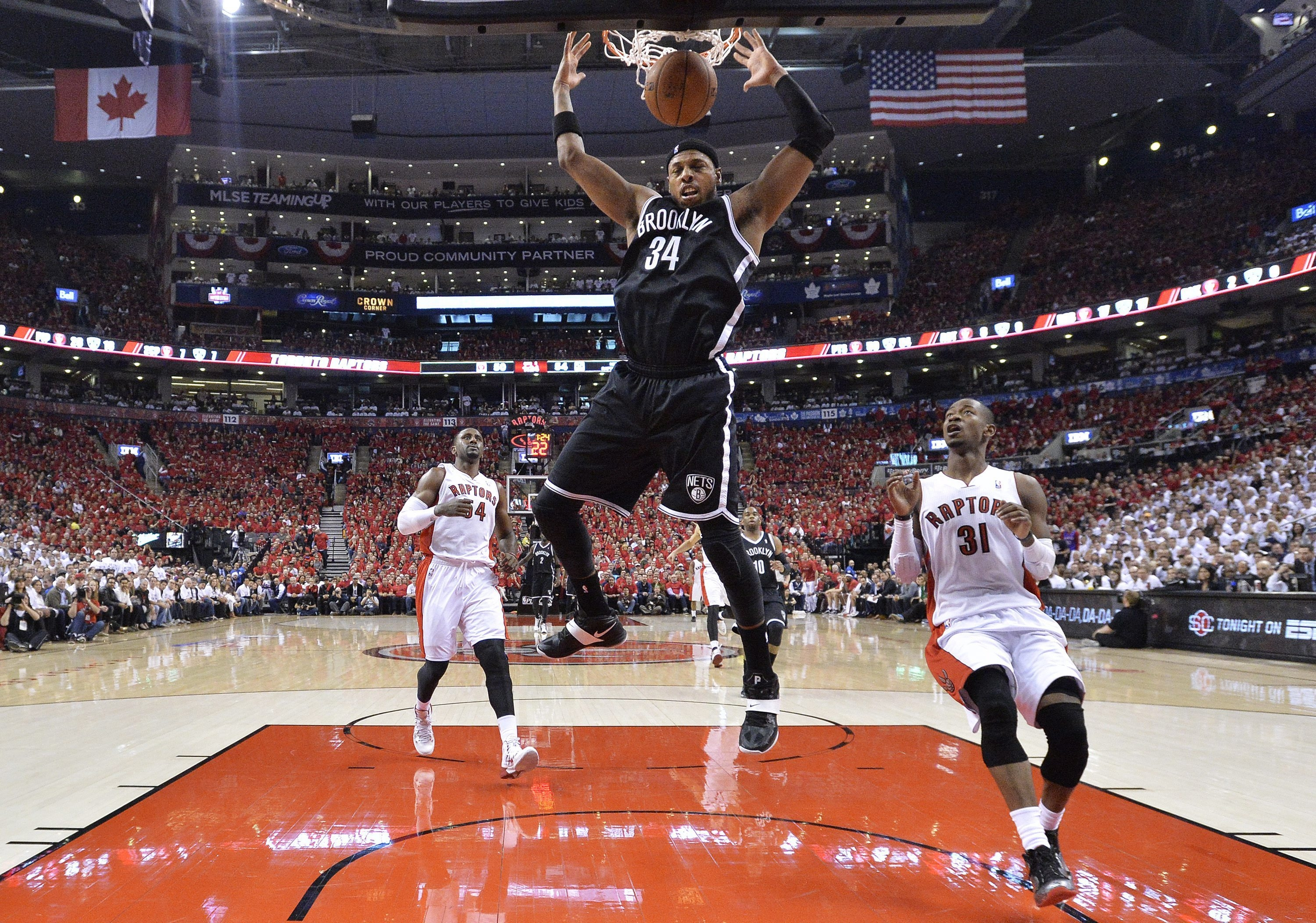 Nets forward Paul Pierce dunks the ball in front of Raptors guard Terrence Ross in Sunday's Game Seven at Air Canada Centre.