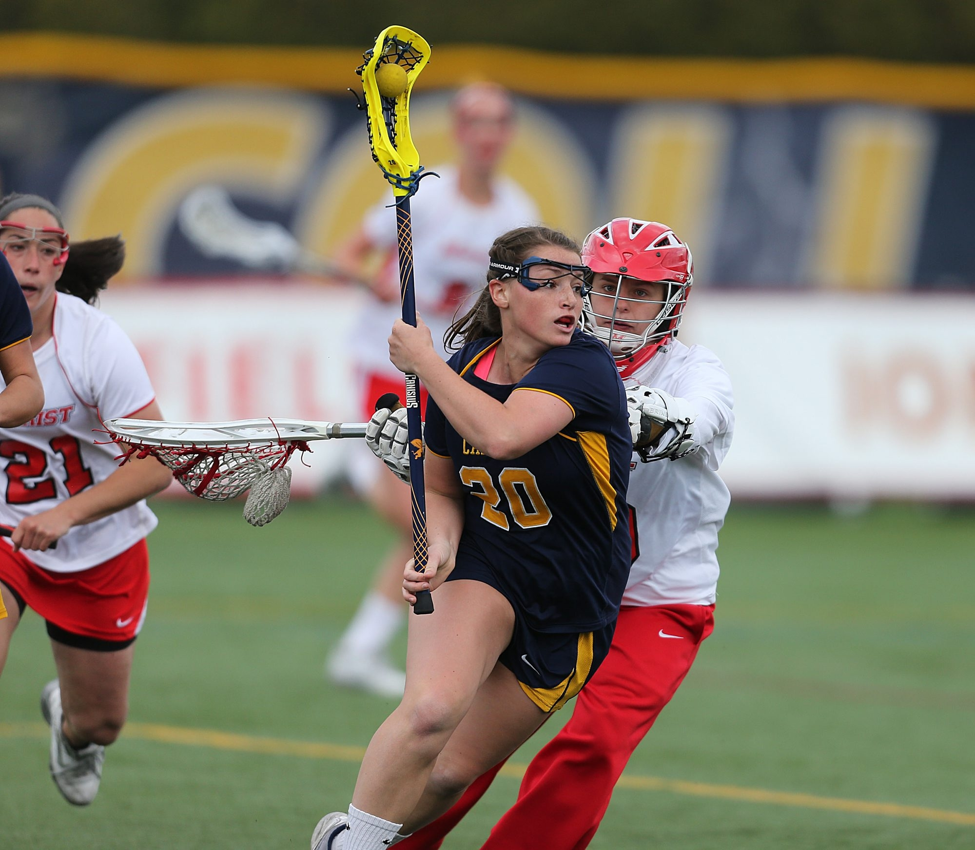 Canisius' Tori Quinn makes a  move on Marist goalkeeper Abigale Witczak during Sunday's MAAC Championship. The Golden Griffins won, 11-9. See a photo gallery at buffalonews.com