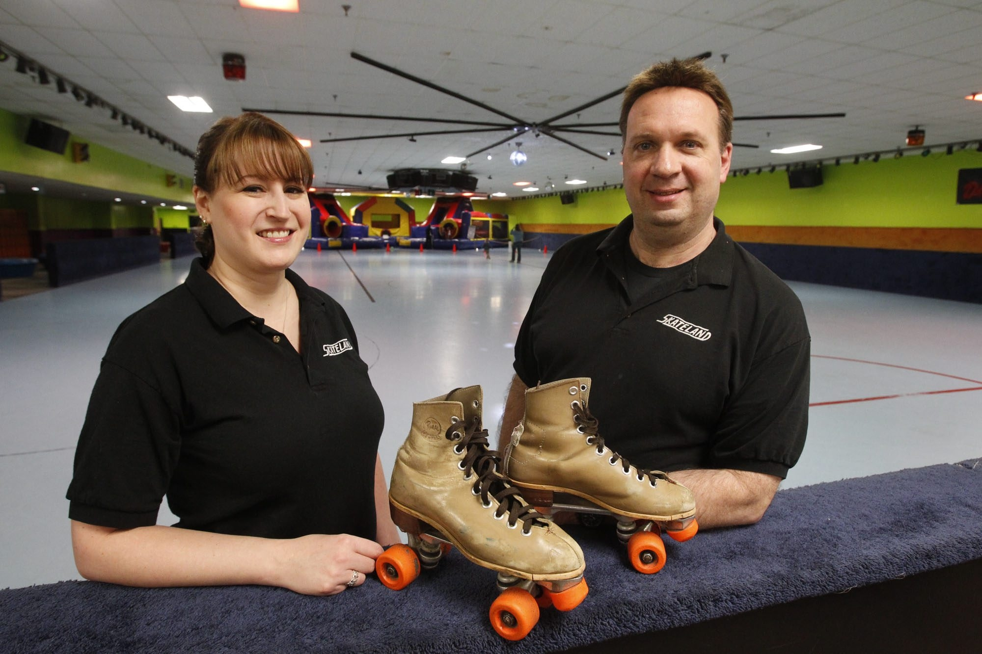 Lori and Brian Ferraro, owners of Skateland on Lincoln Avenue, try to keep their spirits up as they face a May 16 deadline to pay taxes, interest and penalties that are more than two years old. If they don't, the City of Lockport will auction the site.