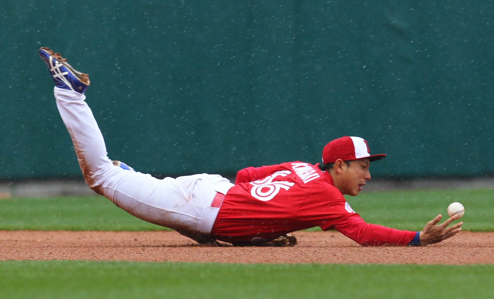 The Bisons' Munenori Kawasaki dives for a grounder during the game with Charlotte at Coca-Cola Field.   file in Buffalo Saturday, May 3, 2014.  (Mark Mulville/Buffalo News)