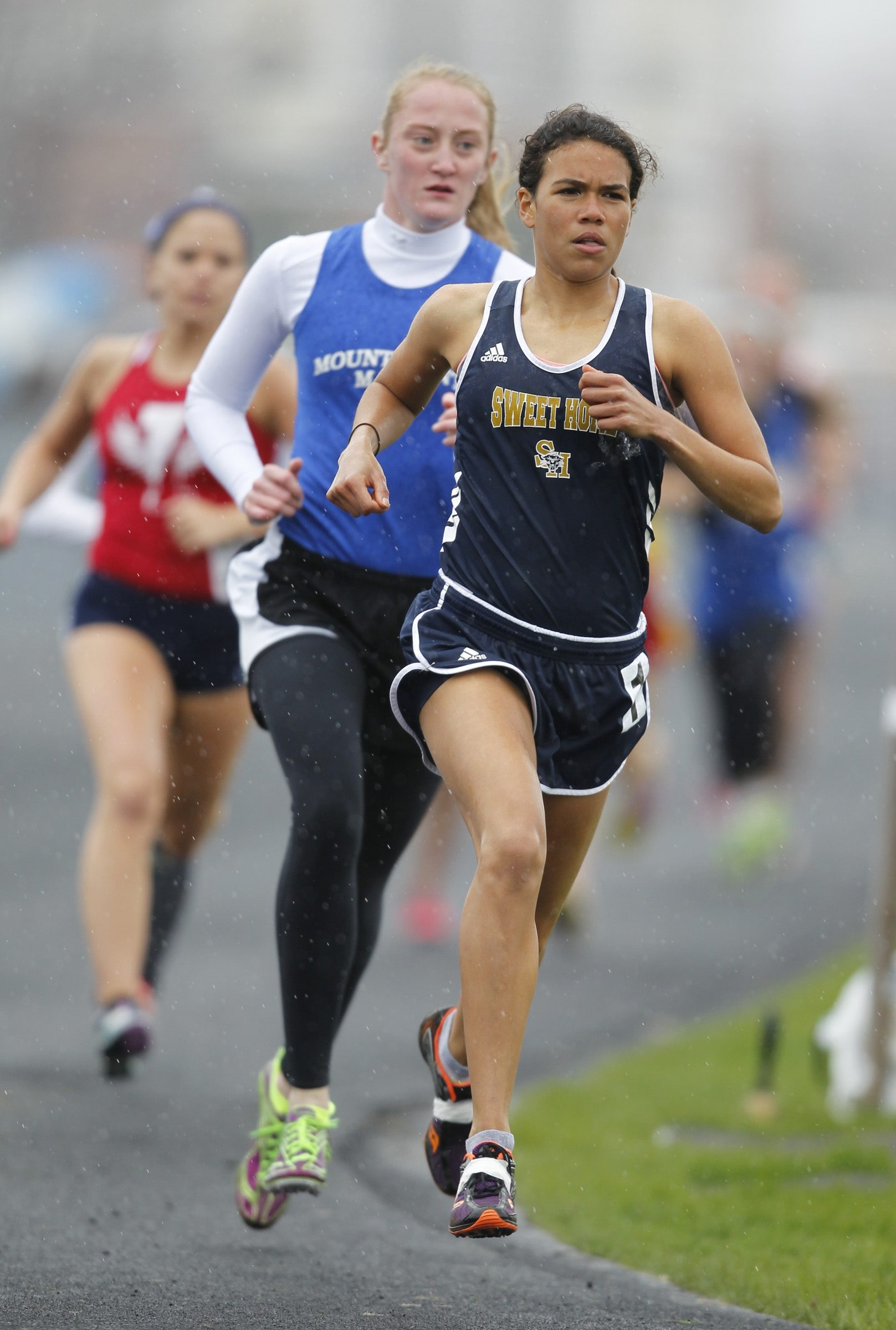 Ally Ortega from Sweet Home wins the girls 3,000 meter run during the ADPRO Sports Panther Invitational  meet at Sweet Home on Saturday.