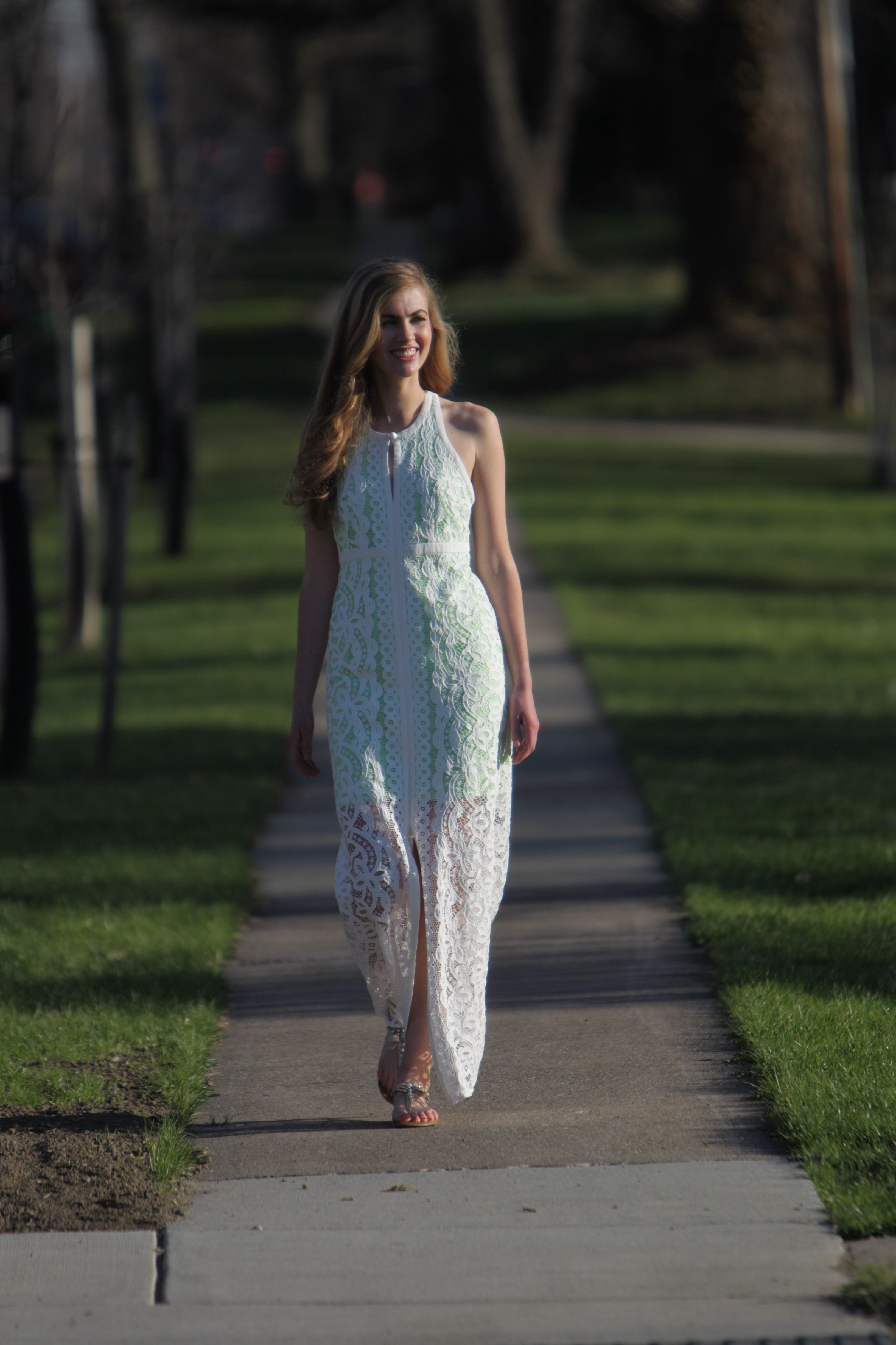 Model Kennedy Copeland takes a stroll in Williamsville during a recent fashion shoot. The maxi dress is from Leelee in Williamsville.