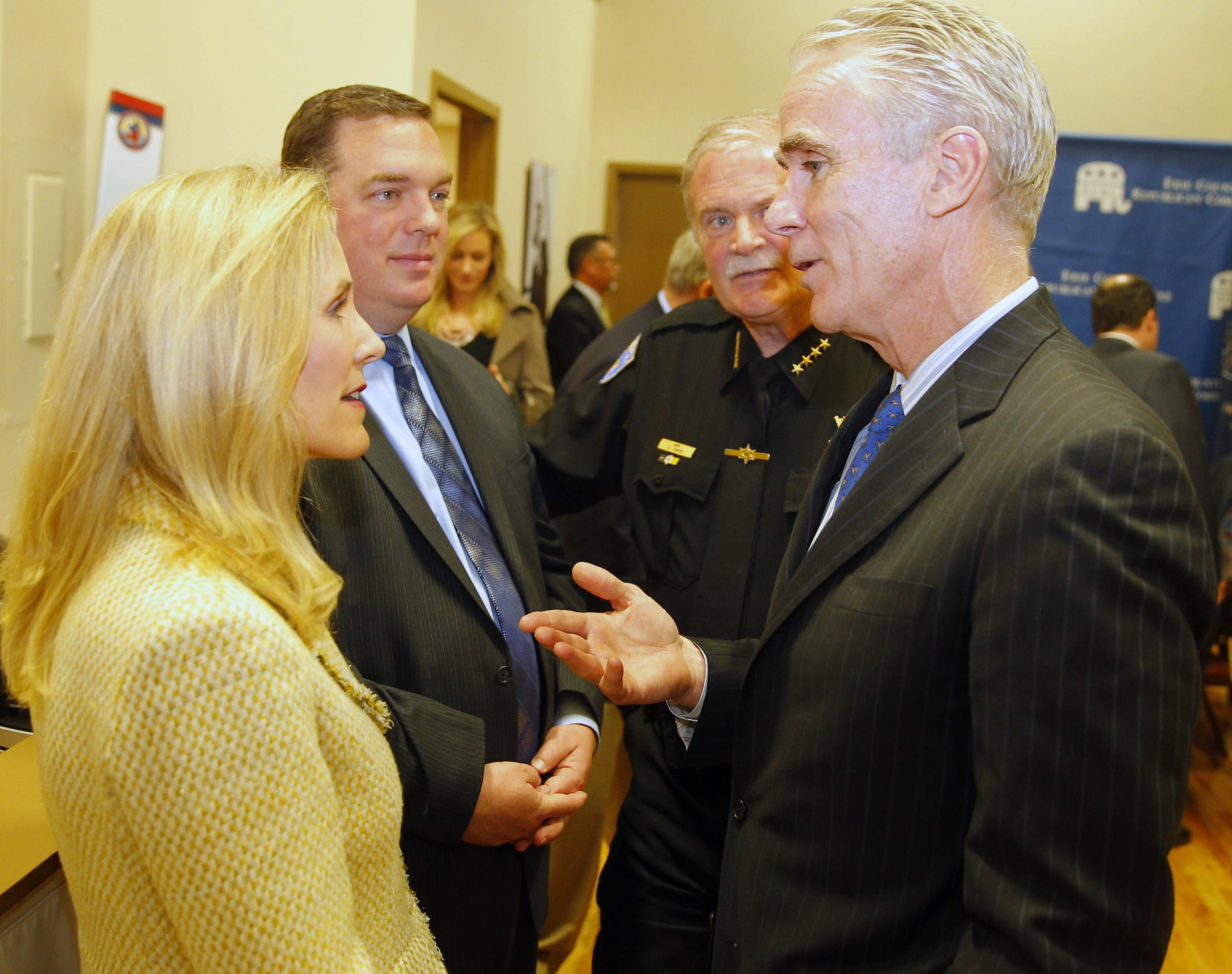 John Cahill, right, talks with, from left, Assemblywoman Jane Corwin, Assemblyman Ray Walter and Erie County Sheriff Tim Howard in Buffalo on Friday.