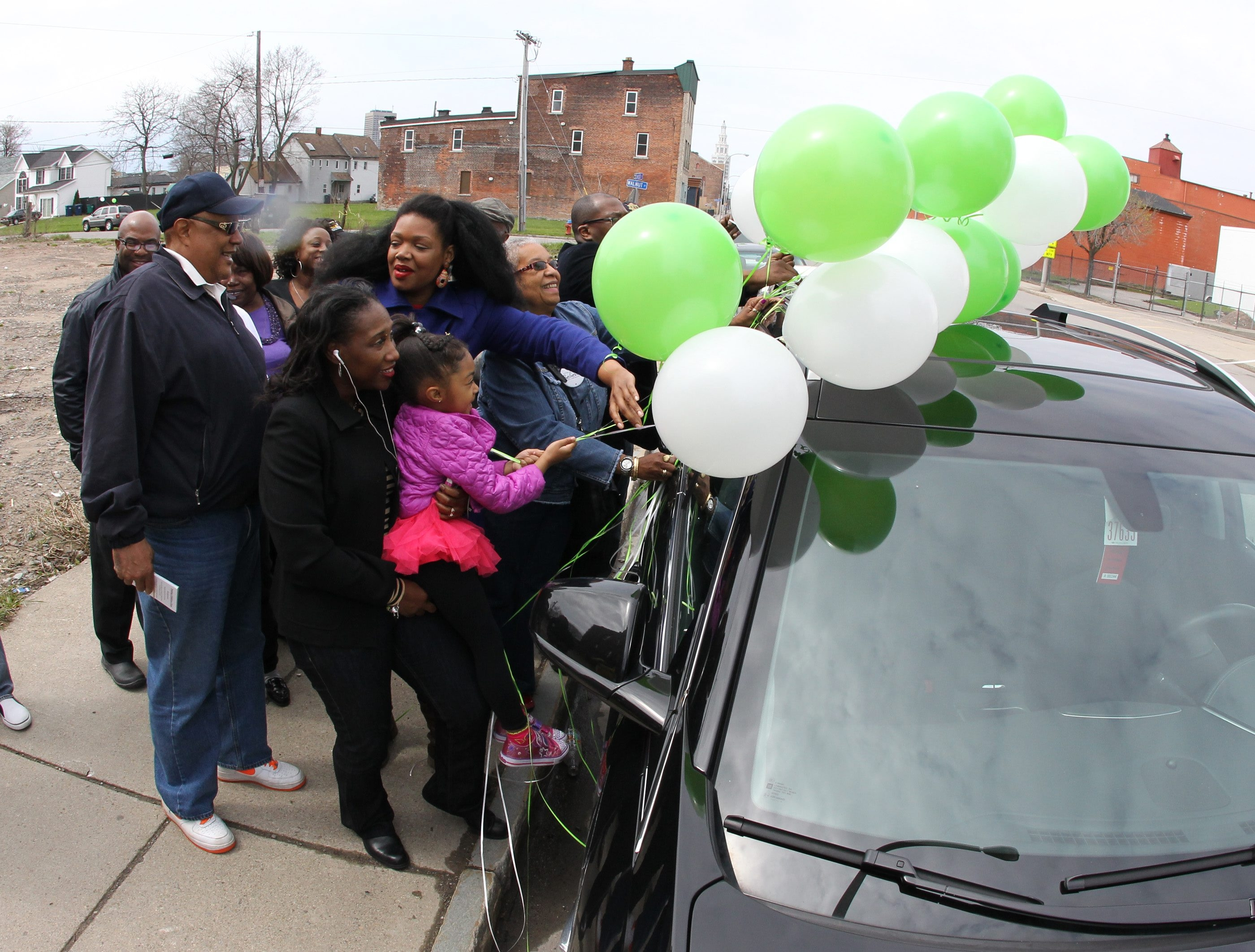 School Board candidates Barbara Seals Nevergold, Gizelle Stokes and Samuel P. Davis tie balloons to car with supporters before driving throughout Buffalo on Saturday, urging people to vote on Tuesday.