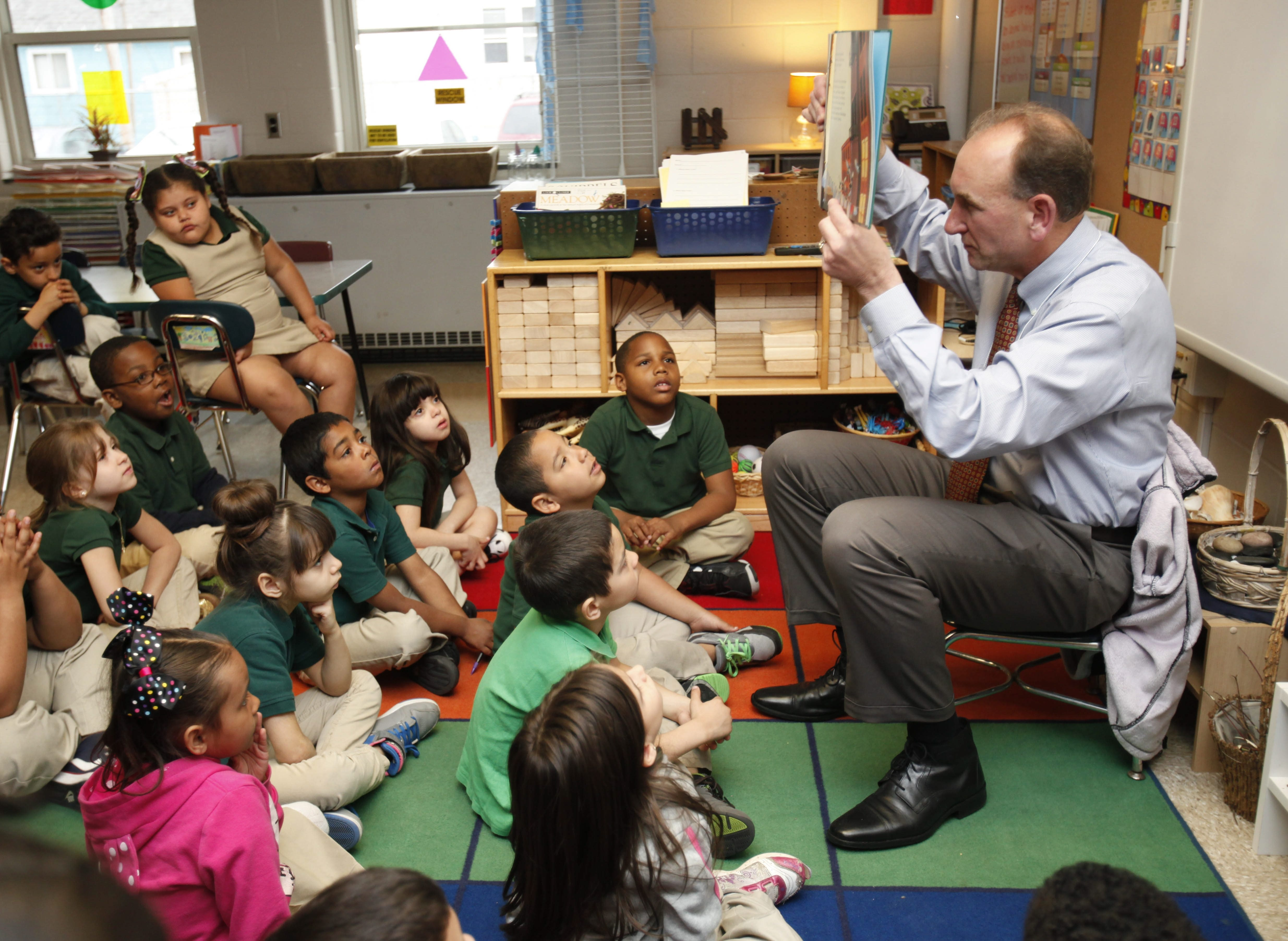 "Buffalo comptroller Mark Schroeder reads to a first grade class at Buffalo Public School 33 during the school's celebration of ""El Dia del Niño"" – the Day of the Child."