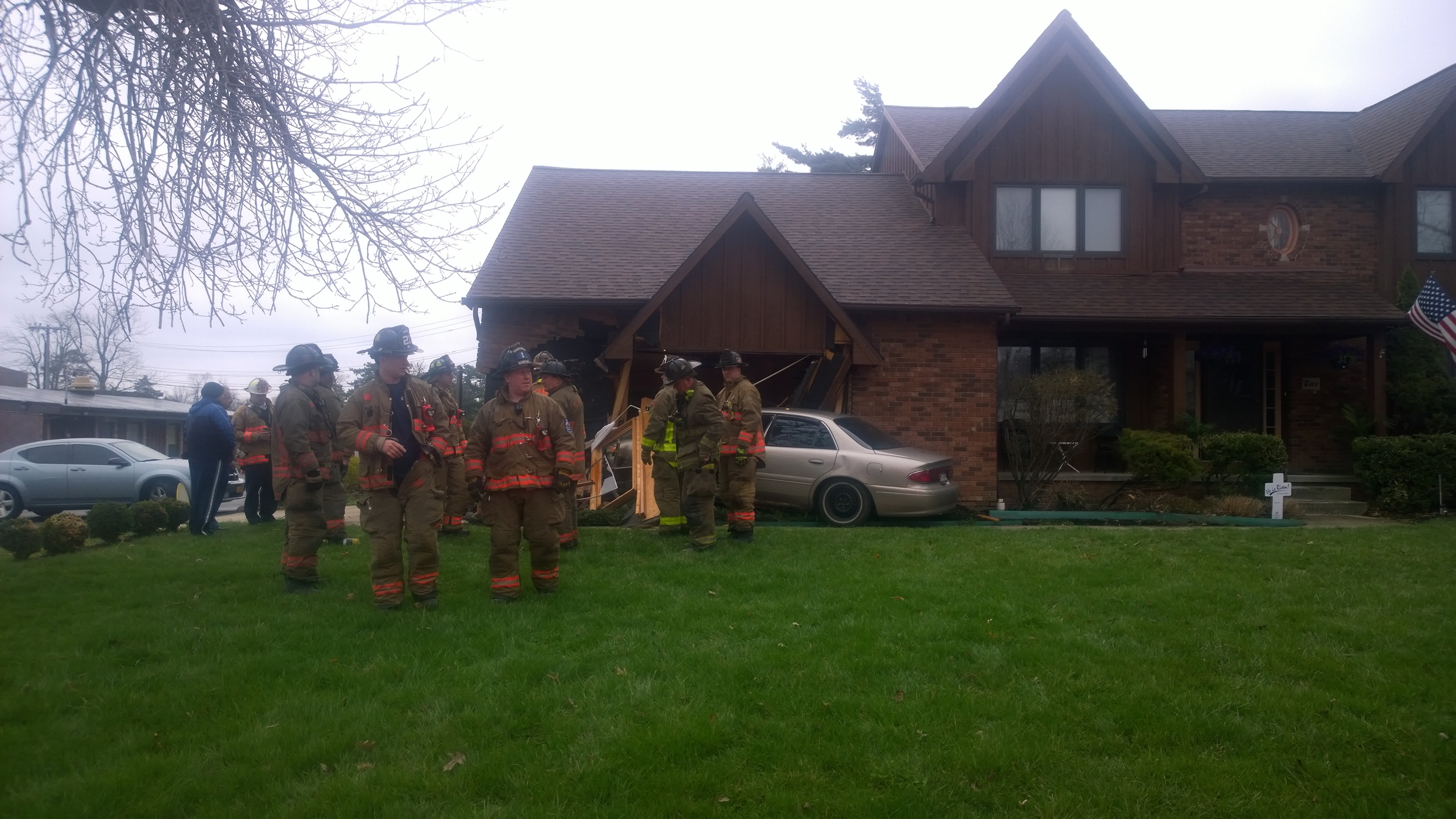 Police and rescue workers respond after a car crashes into a home on Nottingham Terrace early Friday morning.  (Photo by David F. Kazmierczak)