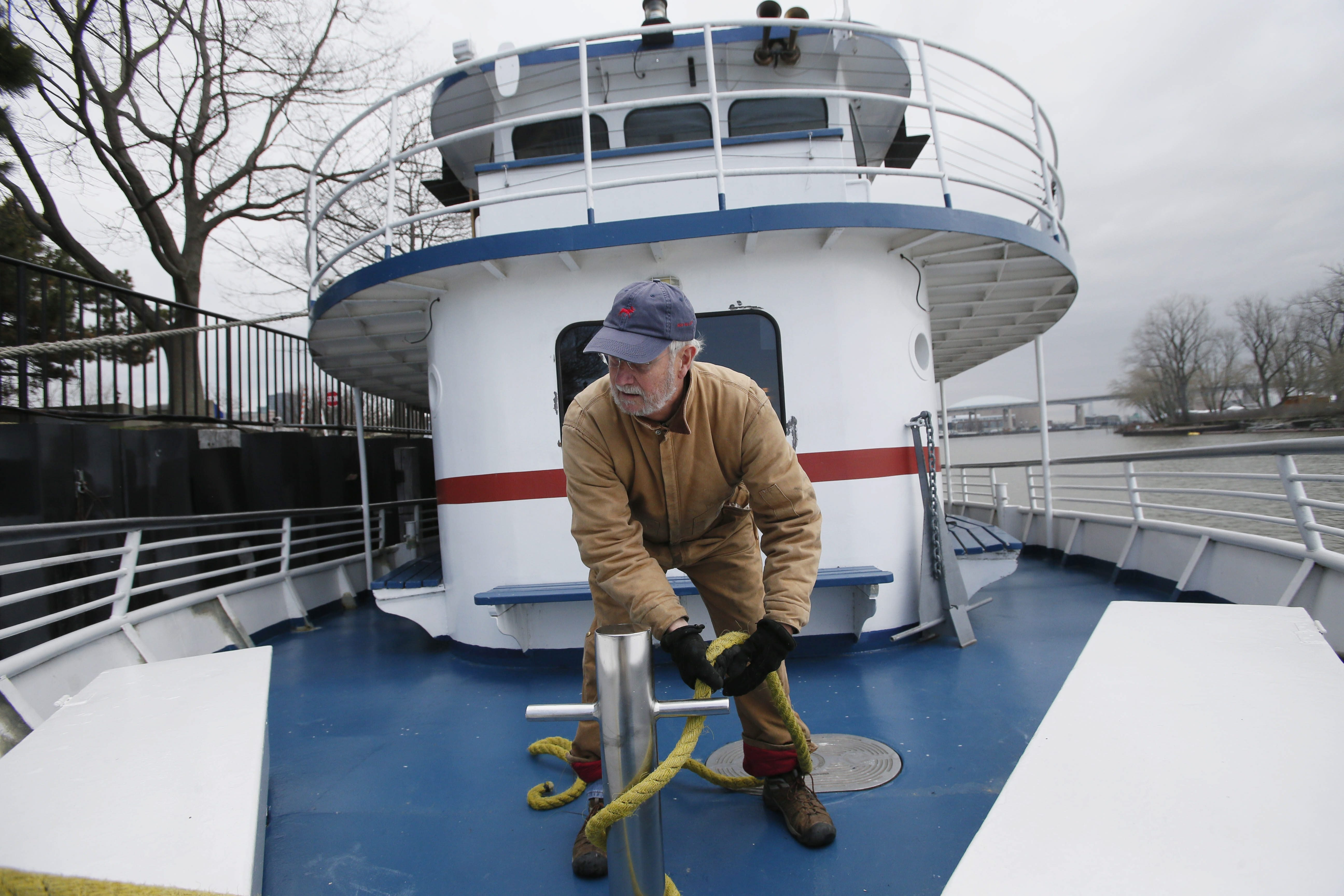 Mike Hayhurst, president of Buffalo Harbor Cruises, ties up  the Miss Buffalo II after arriving in the Buffalo River after making the voyage from its winter storage in the Niagara River to its summer dock in Erie Basin Marina for the season Thursday.