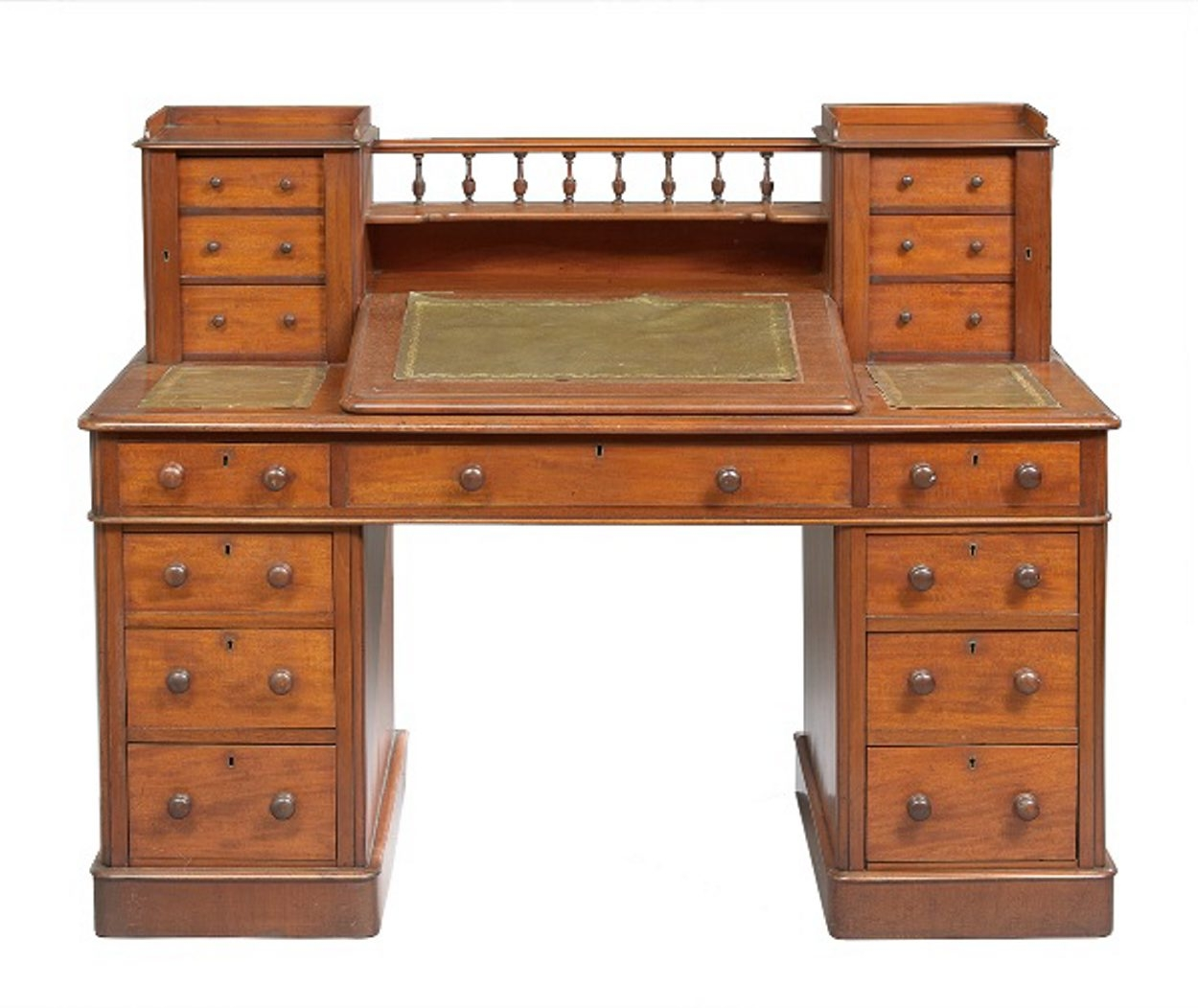This English William IV desk cost only $984 at a New Orleans Auction Galleries sale. That's much less than a new desk of the same quality. The antique desk, made of solid mahogany in about 1830, has two shelves and 15 drawers.
