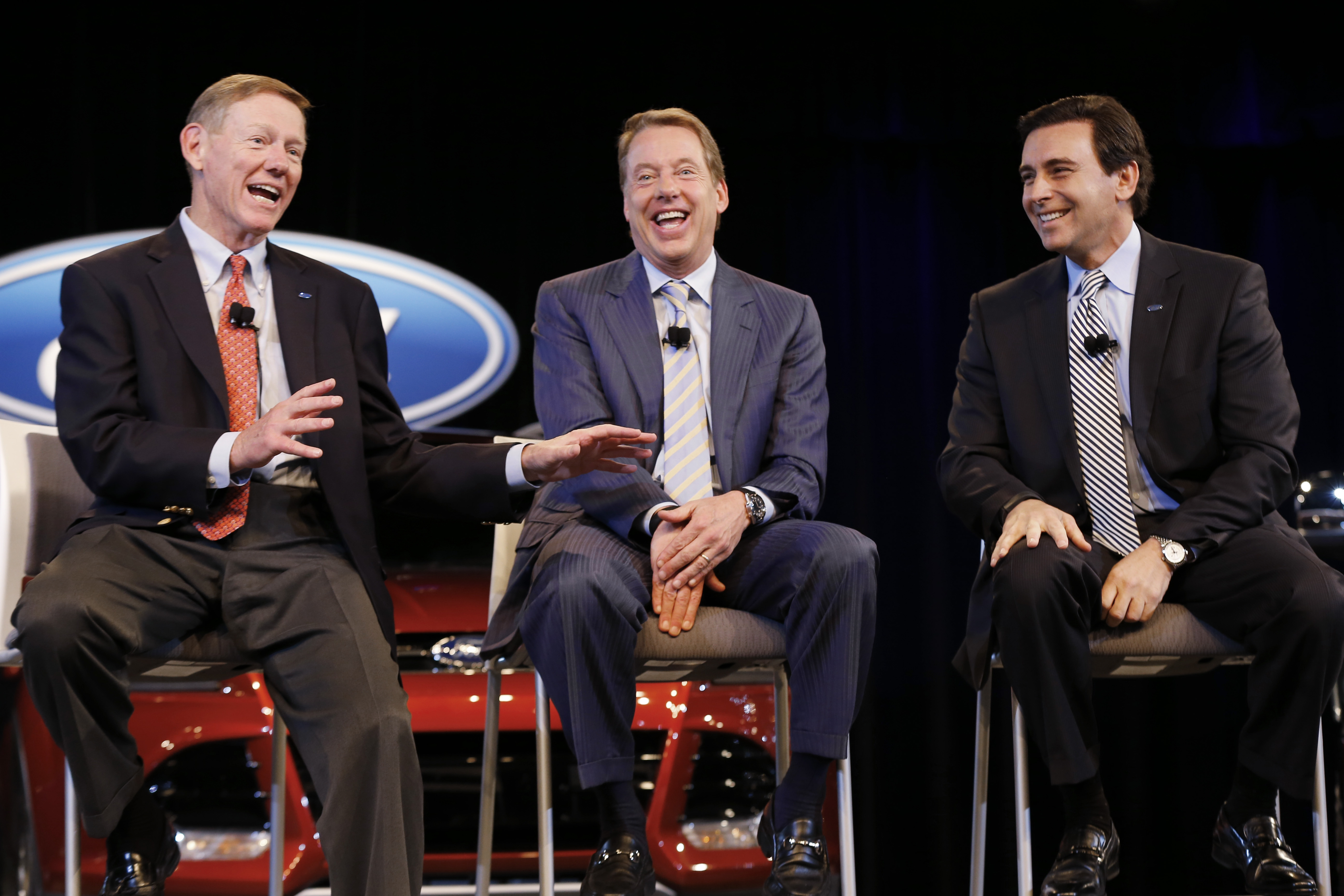 From left, Alan Mulally, president and CEO of Ford Motor Co., Executive Chairman Bill Ford Jr. and Chief Operating Officer Mark Fields speak during Thursday news conference in Dearborn, Mich.