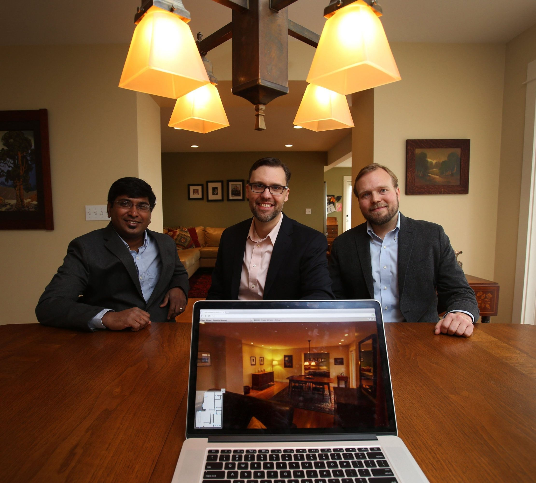 Aravind Kalaiah, left, Rob McGarty and David Eraker of Surefield demonstrate a new type of residential real estate brokerage technology using an interactive tour of a home.