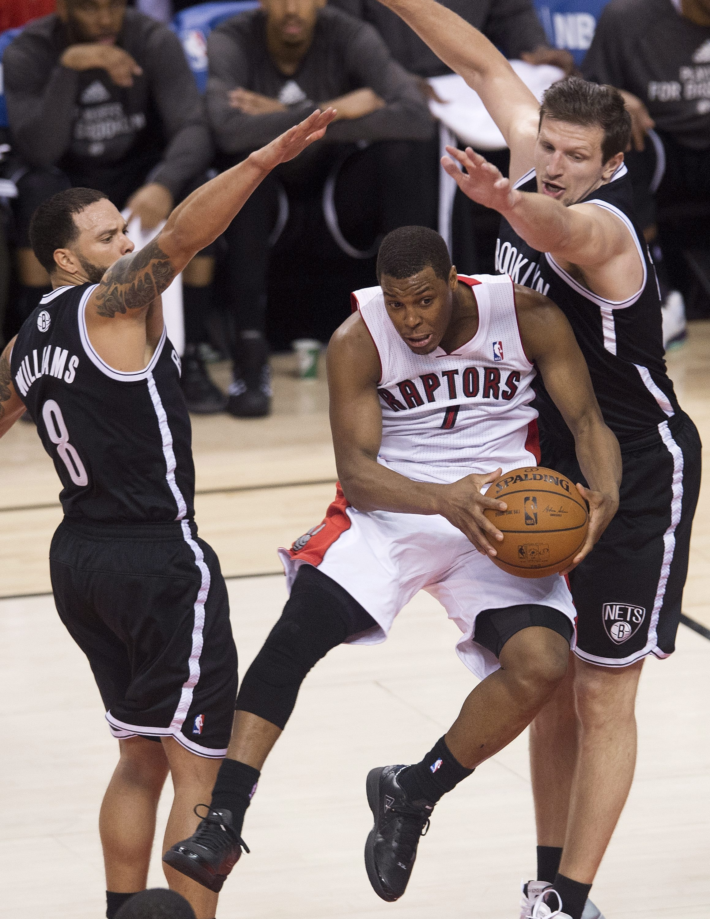 Toronto's Kyle Lowry drives to the net against Brooklyn in Game Five. The Raptors won, 115-113.