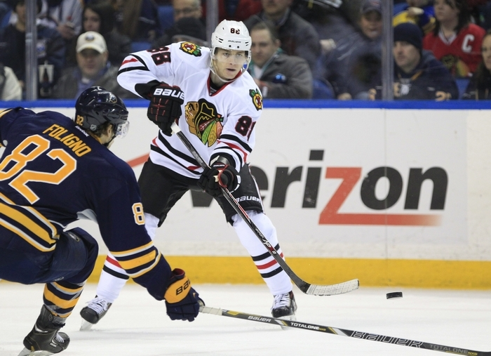 Chicago's Patrick Kane (88) put a pass over the stick of Sabre forward Marcus Foligno in Sunday's game. (Harry Scull Jr./Buffalo News)