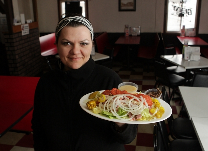 Santino's Pizza Shack & Pub on Clinton Street and Bowen Road in Elma has been around for 40 years. The owner's daughter, Angela Terio, presents the antipasto. (Sharon Cantillon/Buffalo News)