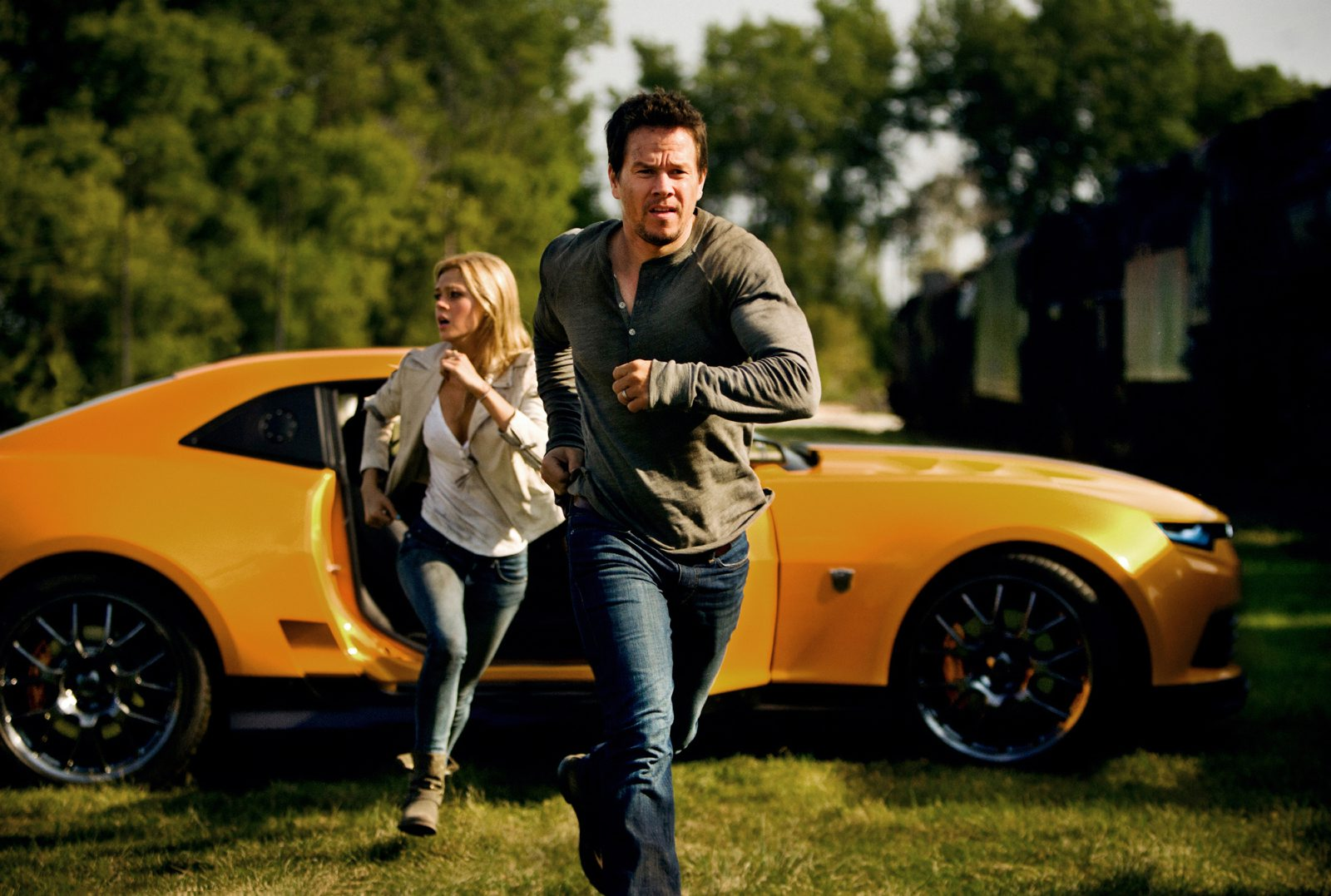 "Nicola Peltz and Mark Wahlberg star in ""Transformers: Age of Extinction."""