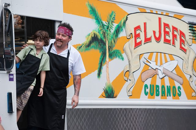 """Emjay Anthony, left, and John Favreau in a scene from """"Chef."""""""