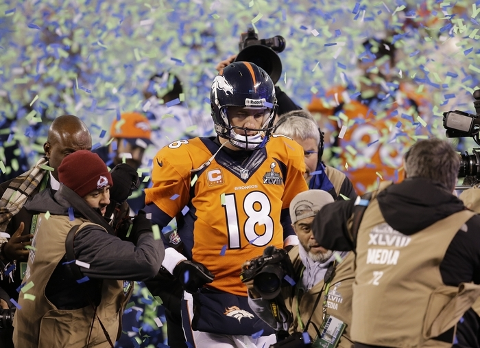 Denver Broncos quarterback Peyton Manning walks off the field a beaten man as Seattle strangled Manning and the NFL's top-rated offense. (Associated Press)
