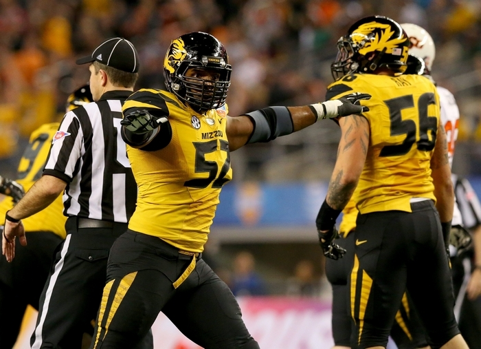 Michael Sam's Missouri teammates had no problem with him being gay as he helped the Tigers to a 12-2 mark. (Getty Images)