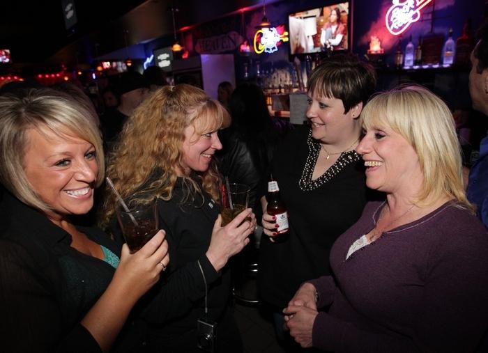 Gathering on a Friday night at Rock 'n' Roll Heaven are, from left, Jamie DiFrancesco, Linda Scheuneman, Kim Prenatt and Liz King.