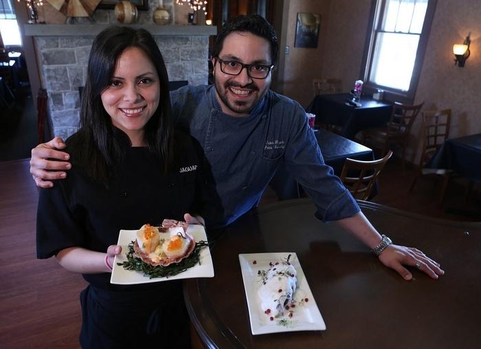Diana Parra Gonzalez, left, and Chef Victor Parra Gonzalez with the scallop appetizer and the stuffed pepper. (Photos by Charles Lewis/Buffalo News)