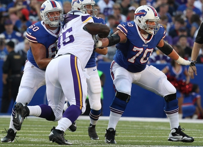 Bills guard Kraig Urbik, left, and center Eric Wood (70) are two members of a unit that make up the NFL's largest starting offensive line.  (James P. McCoy/ Buffalo News)