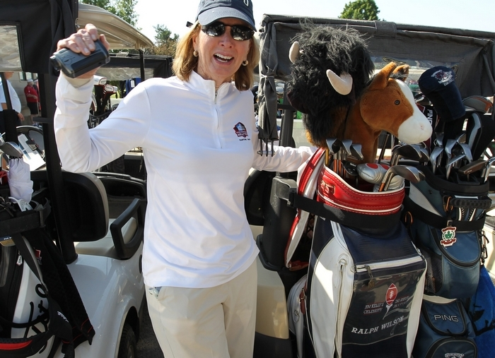 Mary Wilson shows off the golf bag her late husband received at the second Kelly Celebrity Golf Classic back in 1988. (James P. McCoy/Buffalo News)