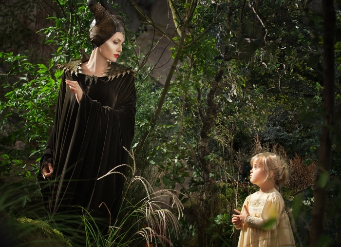 "Angelina Jolie as Maleficent, left, with her daughter Vivienne Jolie-Pitt, portraying Young Aurora, in a scene from the film ""Maleficent."""