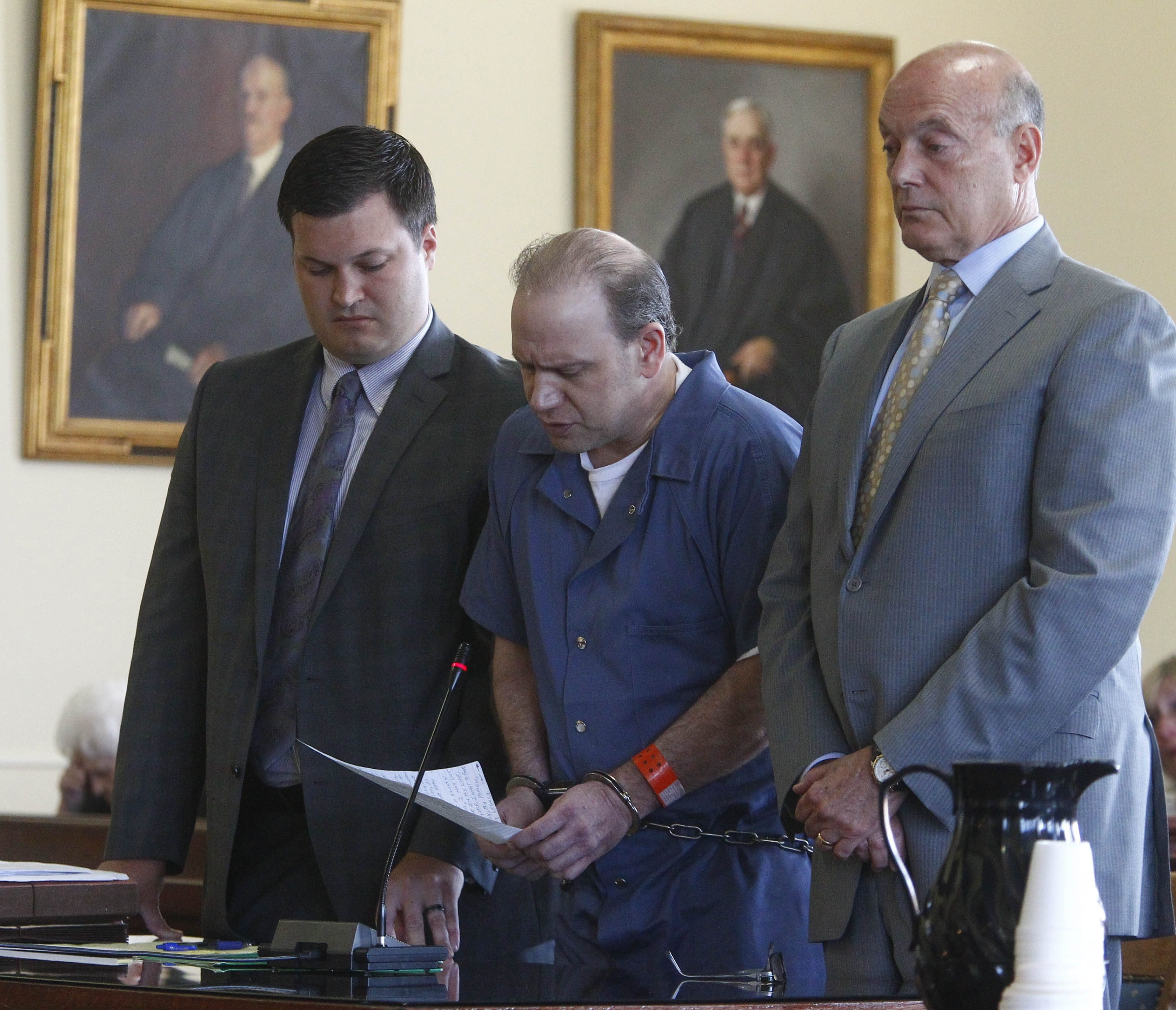 Timothy C. DePetris, center, with Brian Hutchison, defense  co-counsell, left, and George Muscato , defense attorney, was sentenced to 25 years in prison today for shooting his brother-in-law. (John Hickey/Buffalo News)