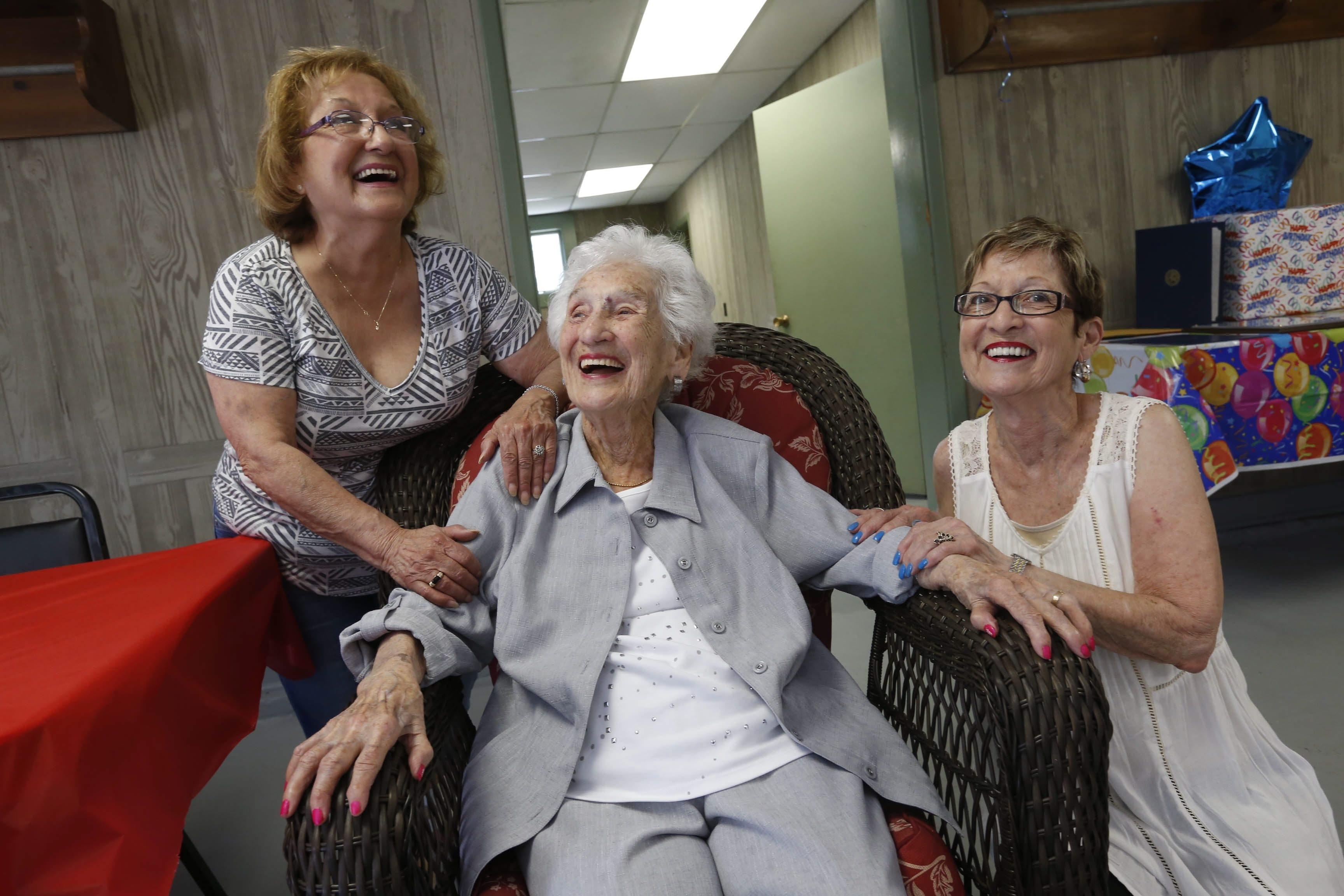 Carmela Trippi celebrates her 105th birthday with daughters Arlene Vincent, left, and Ann Barone at Friendship House in Ellicott Creek Park on Sunday.