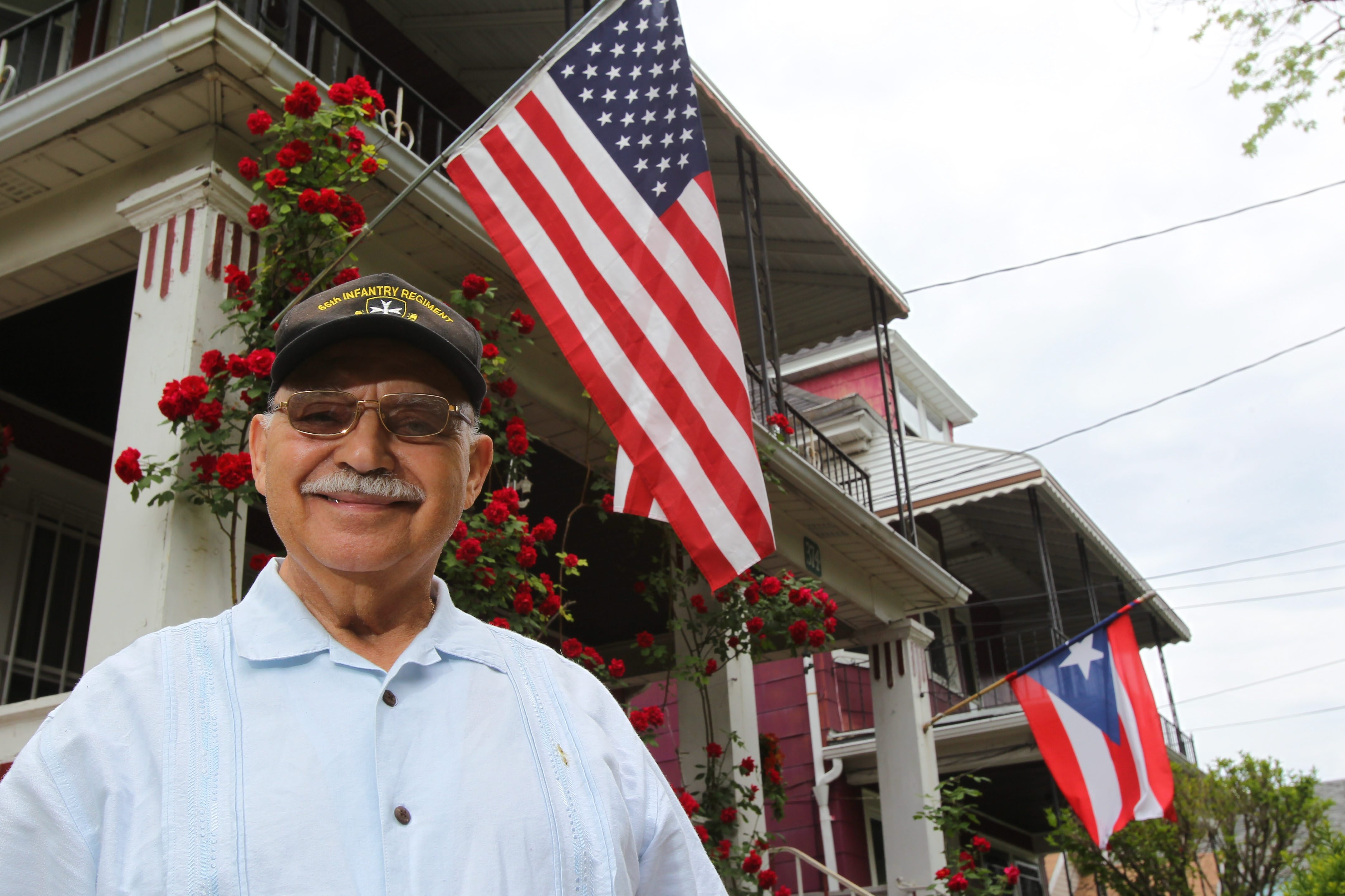 Juan Negron served during the Korean War in the segregated 65th Amy Regiment, that was for Puerto Rican soldiers.  He stands in front of his home in Buffalo Wednesday, June 18 , 2014.  (Mark Mulville/Buffalo News)