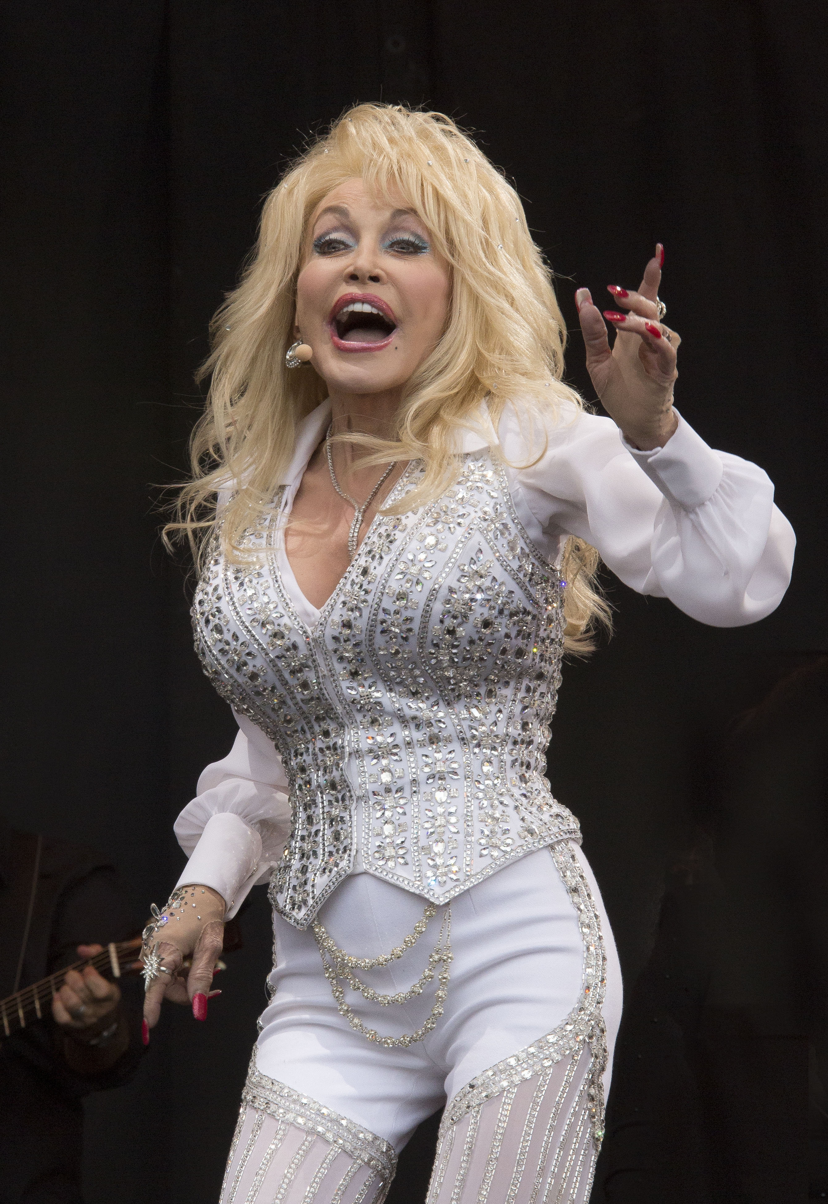 Dolly Parton performs on the main Pyramid stage Sunday at Glastonbury music festival in England, where thousands of hard rock fans have arrived for the annual event.