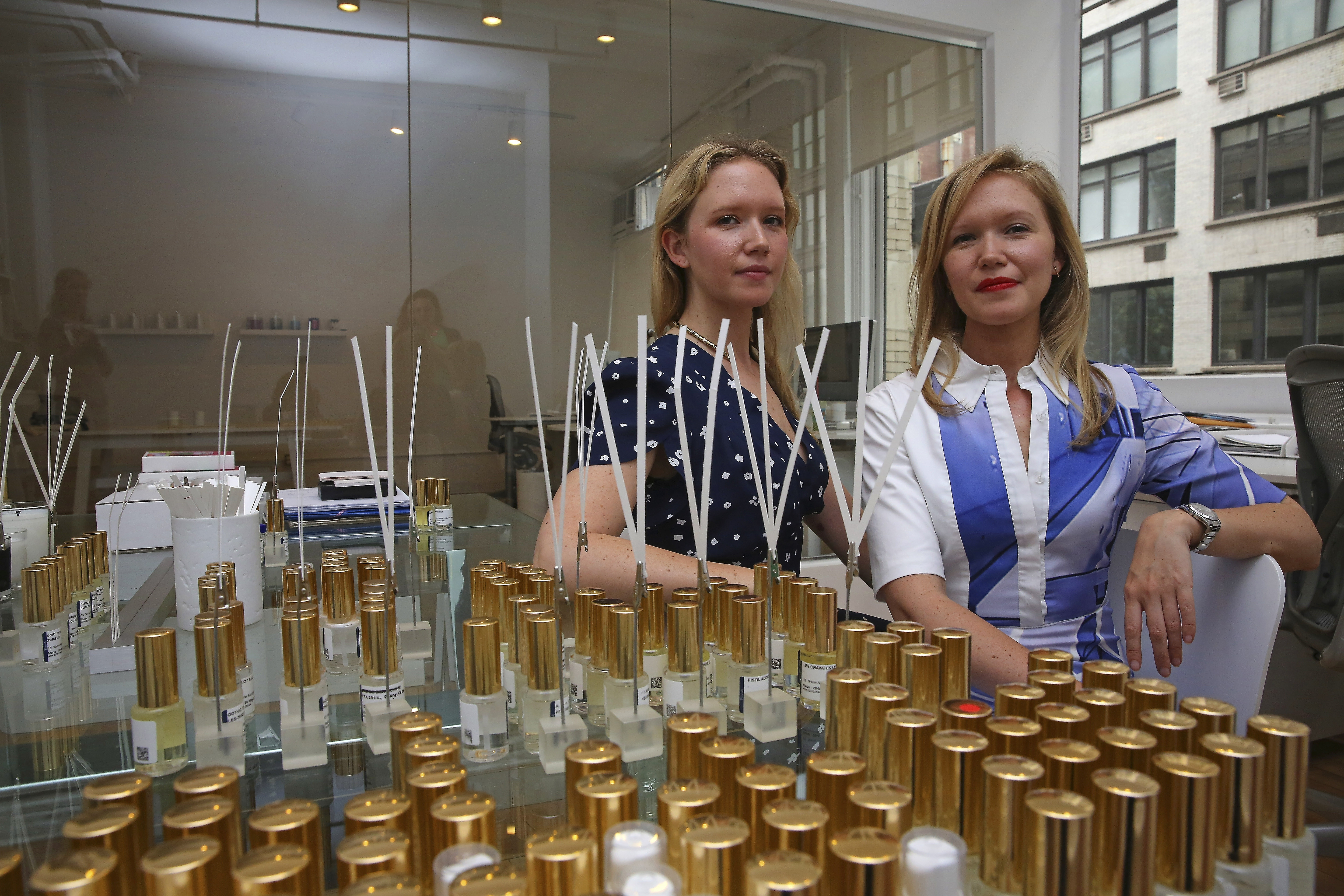 Sisters Dawn, left, and Samantha Goldworm at their offices in New York, June 10, 2014. The Goldworm's run an þÄúolfactive brandingþÄù company, one of many companies around the country offering scent technologies in the trend of well-designed interiors complete only with an interesting scent. (Nicole Bengiveno/The New York Times)