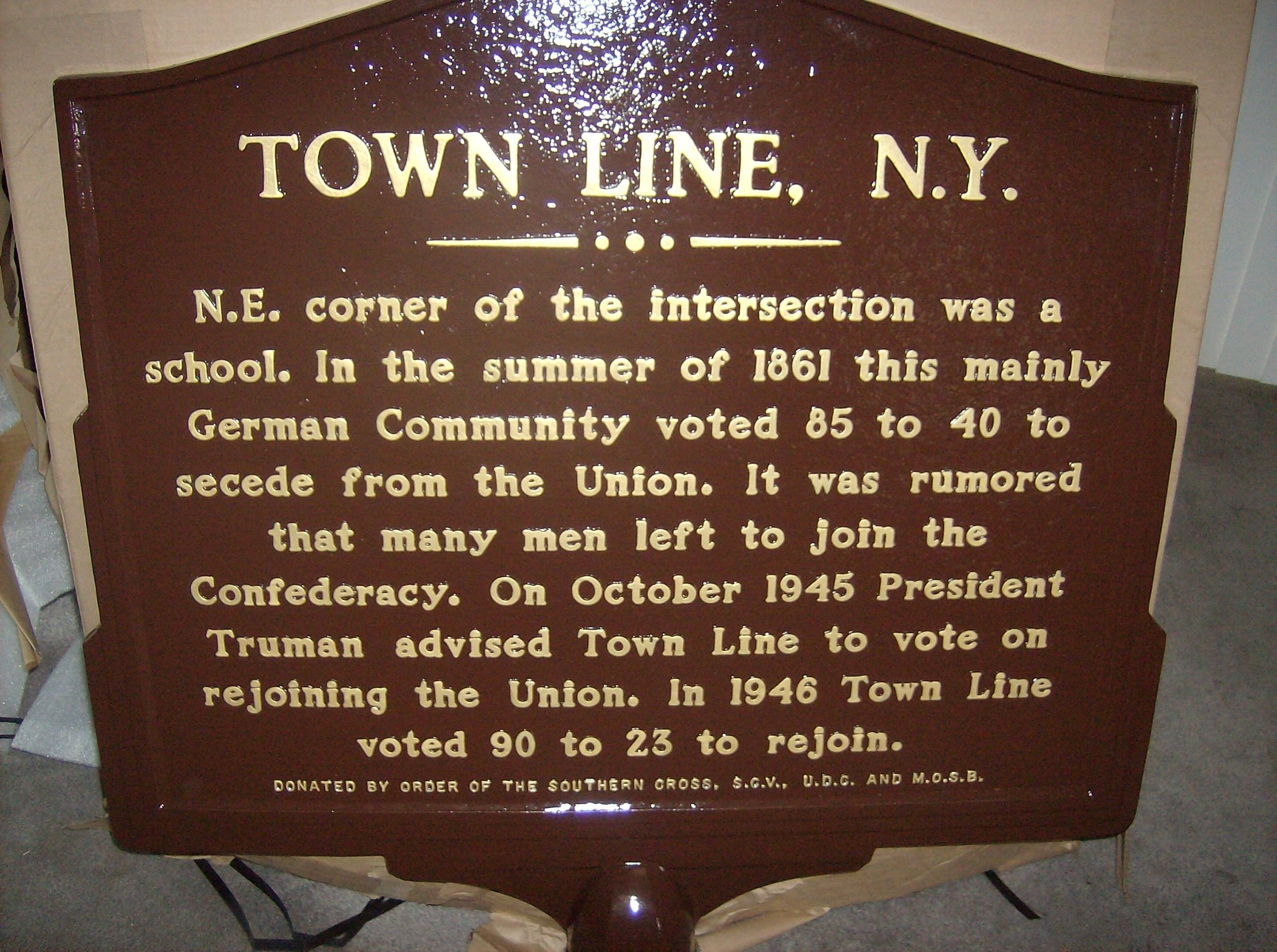 Some consider the Town Line secession plaque funded by the Sons of the Confederacy, left, and the plaque that sits on the property of the Town Line Lutheran Church in Alden to be symbols of unification.