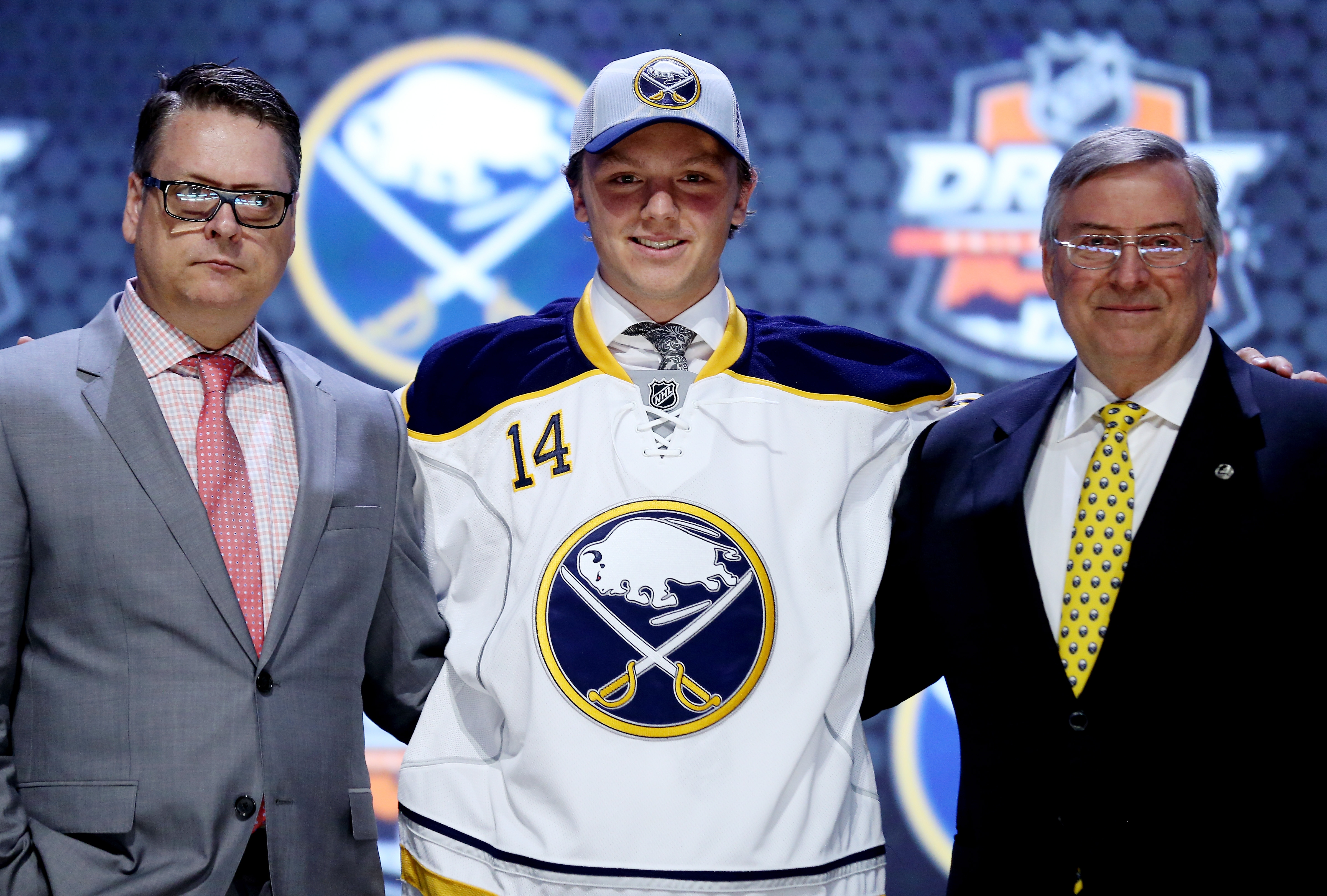 Sam Reinhart's vision of wearing Sabres colors became reality Friday as general manager Tim Murray, left, and owner Terry Pegula drafted the center No. 2 overall.