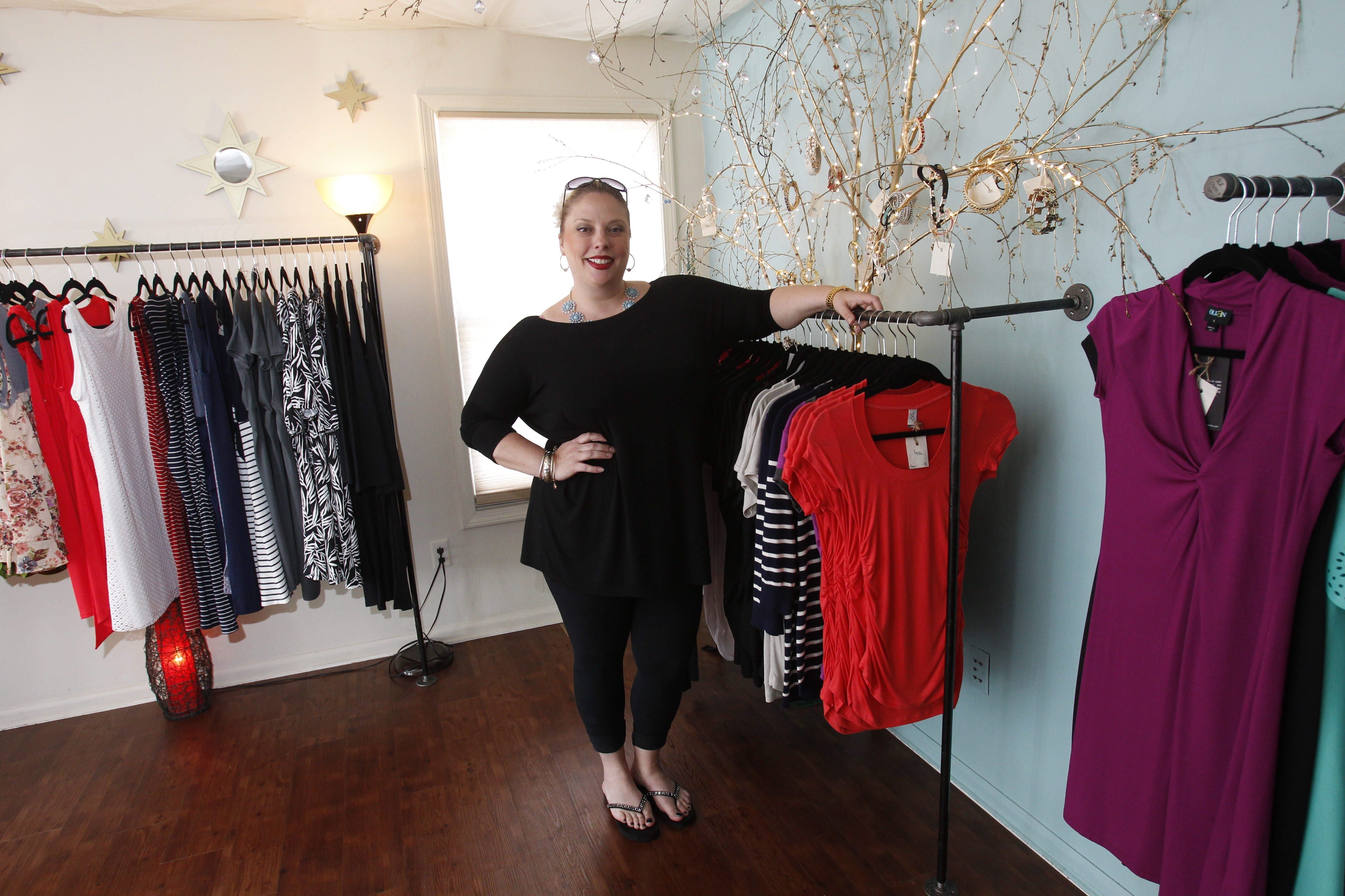 Lou Ann Cane is the owner of Bee Maternal Luxe Maternity on Main St. in Williamsville.  She sells maternity clothing and other related products.  Photo taken, Monday, June 23, 2014.  (Sharon Cantillon/Buffalo News)
