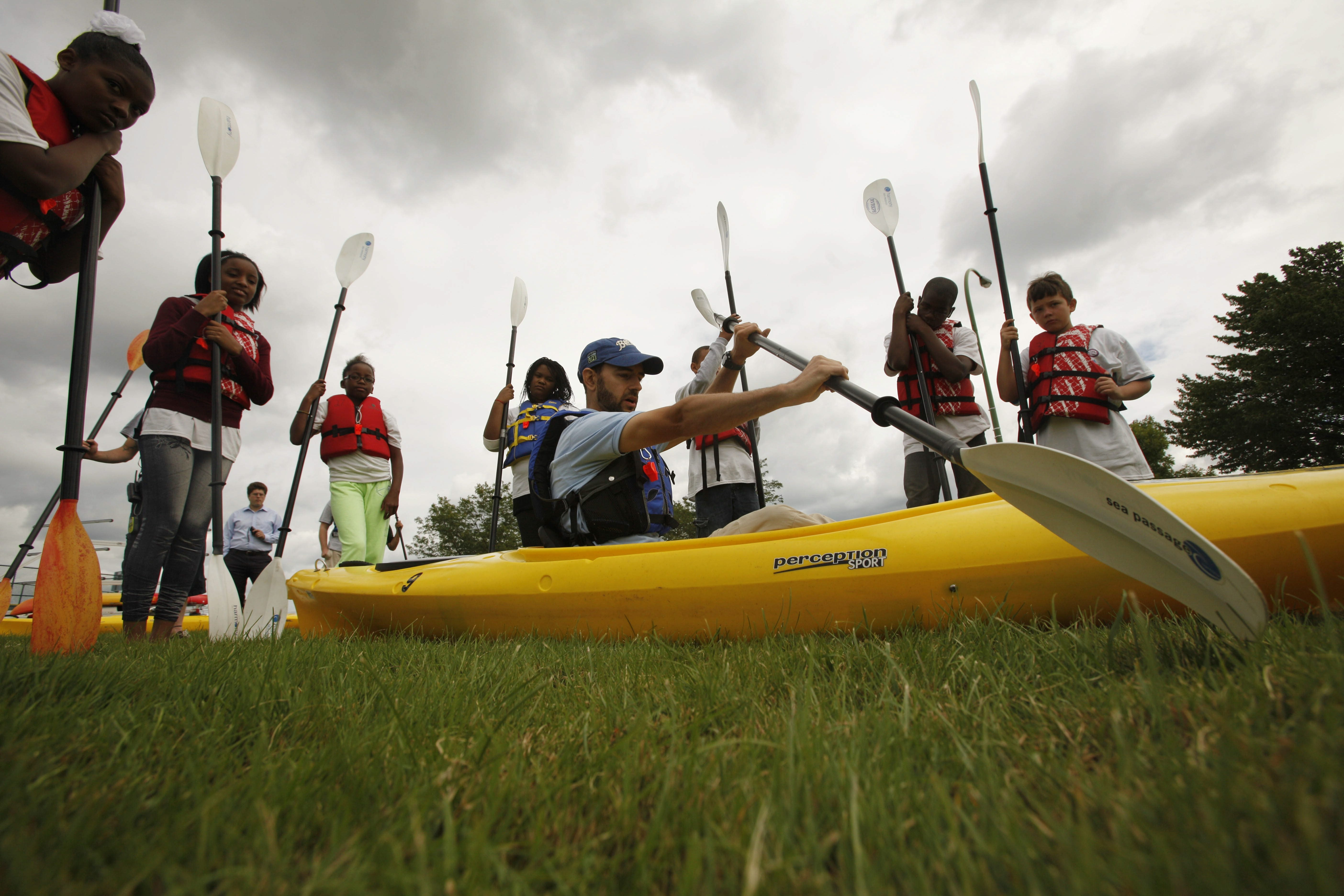 """Chris Murawski, river watch program coordinator for Buffalo Niagara Riverkeeper, gives a lesson on kayaking before hitting the water with students participating in the """"Honeywell Adventures in Environmental Leadership"""" program in Hyde Park in Niagara Falls, Monday, July 29, 2013.  (Derek Gee/Buffalo News)"""