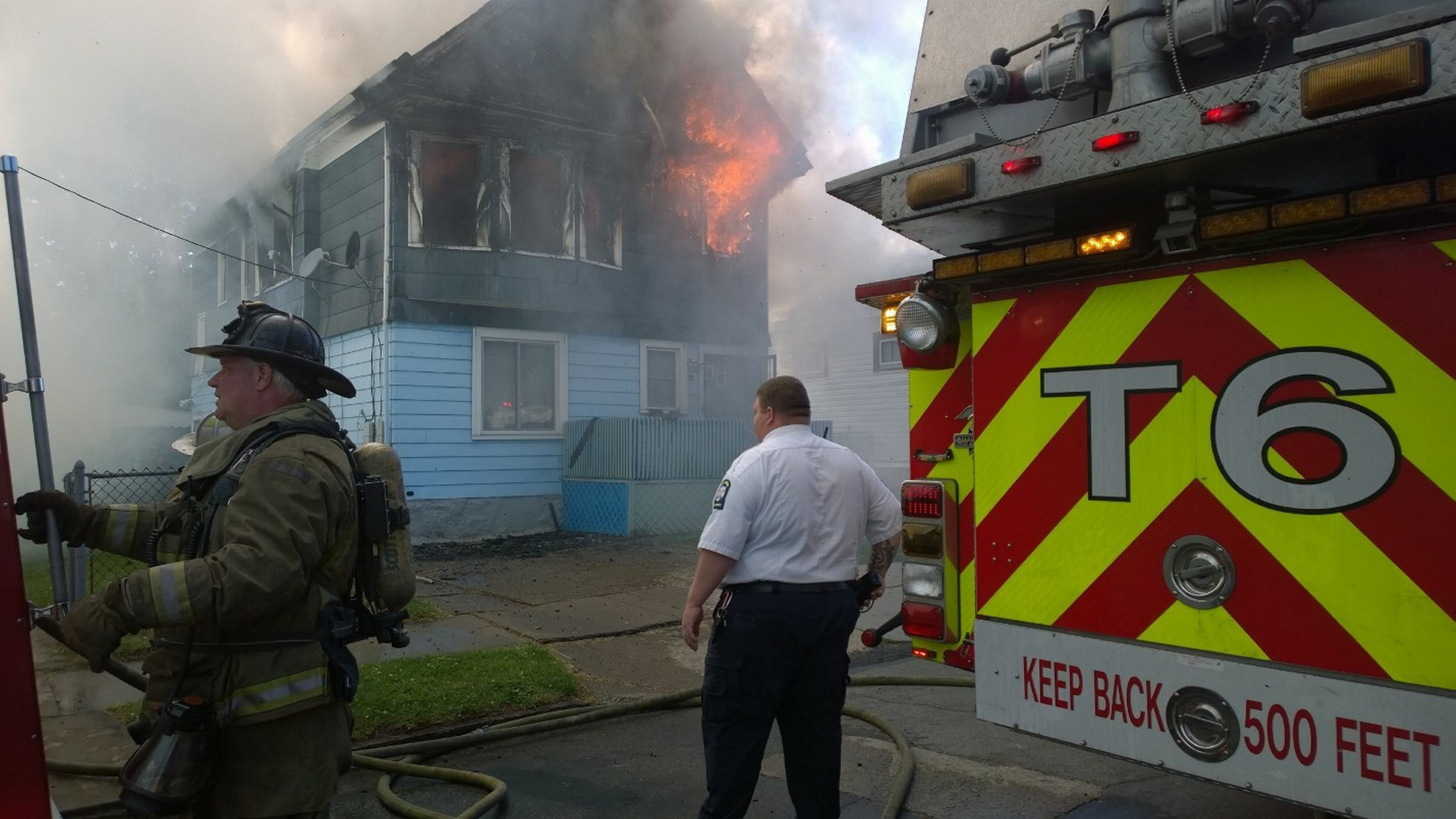 Firefighters and rescue personnel respond to the blaze at 18 Regina Place, where man died and son was saved.