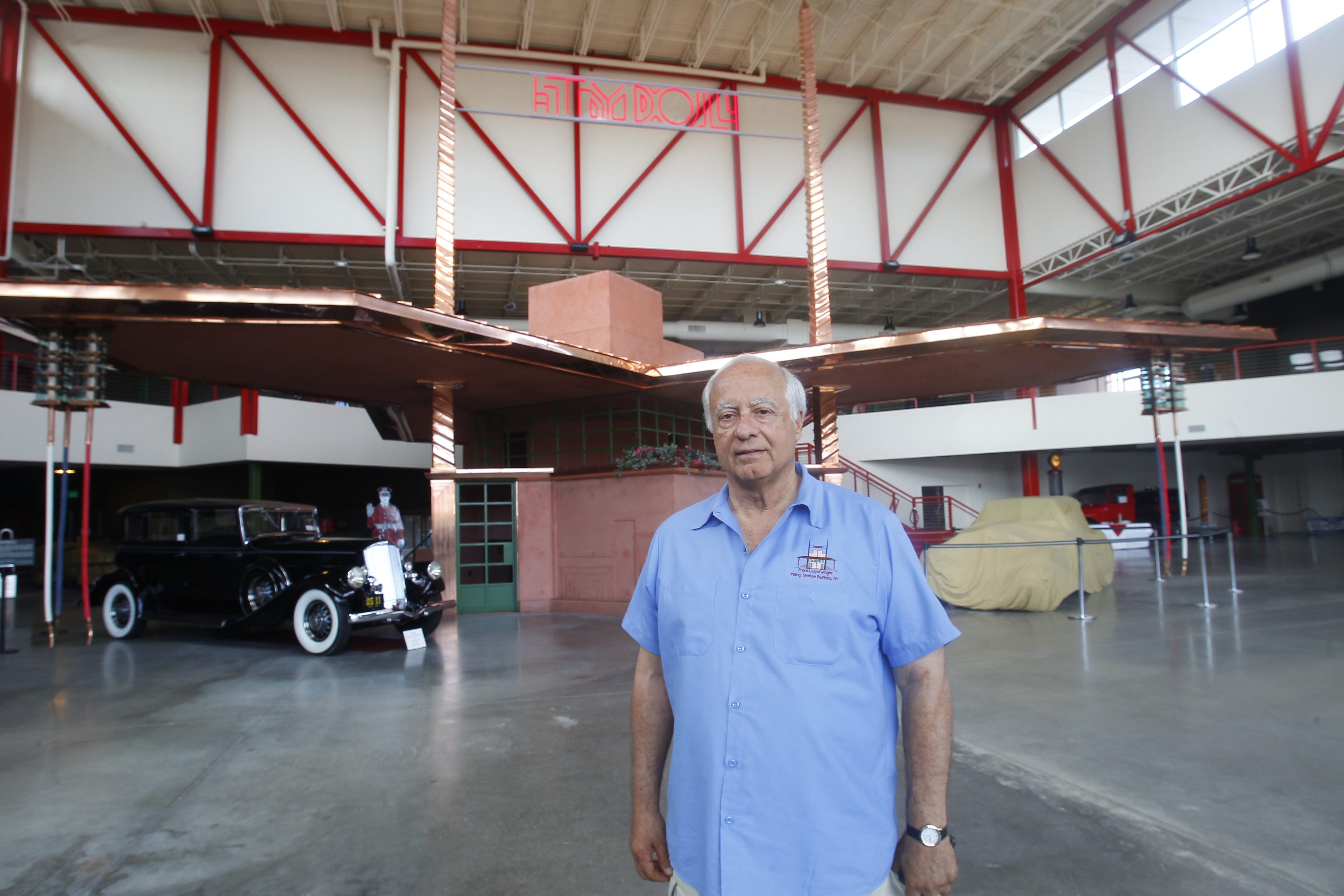 James Sandoro, Founder and Executive Director at the Buffalo Transportation Pierce-Arrow Museum's with the Frank Lloyd Wright-designed filling station behind him opens Friday at The Buffalo Transportation Pierce-Arrow Museum, corner of Seneca Street and Michigan Avenue  on Thursday, June 26, 2014 in Buffalo, NY.  (John Hickey/Buffalo News)