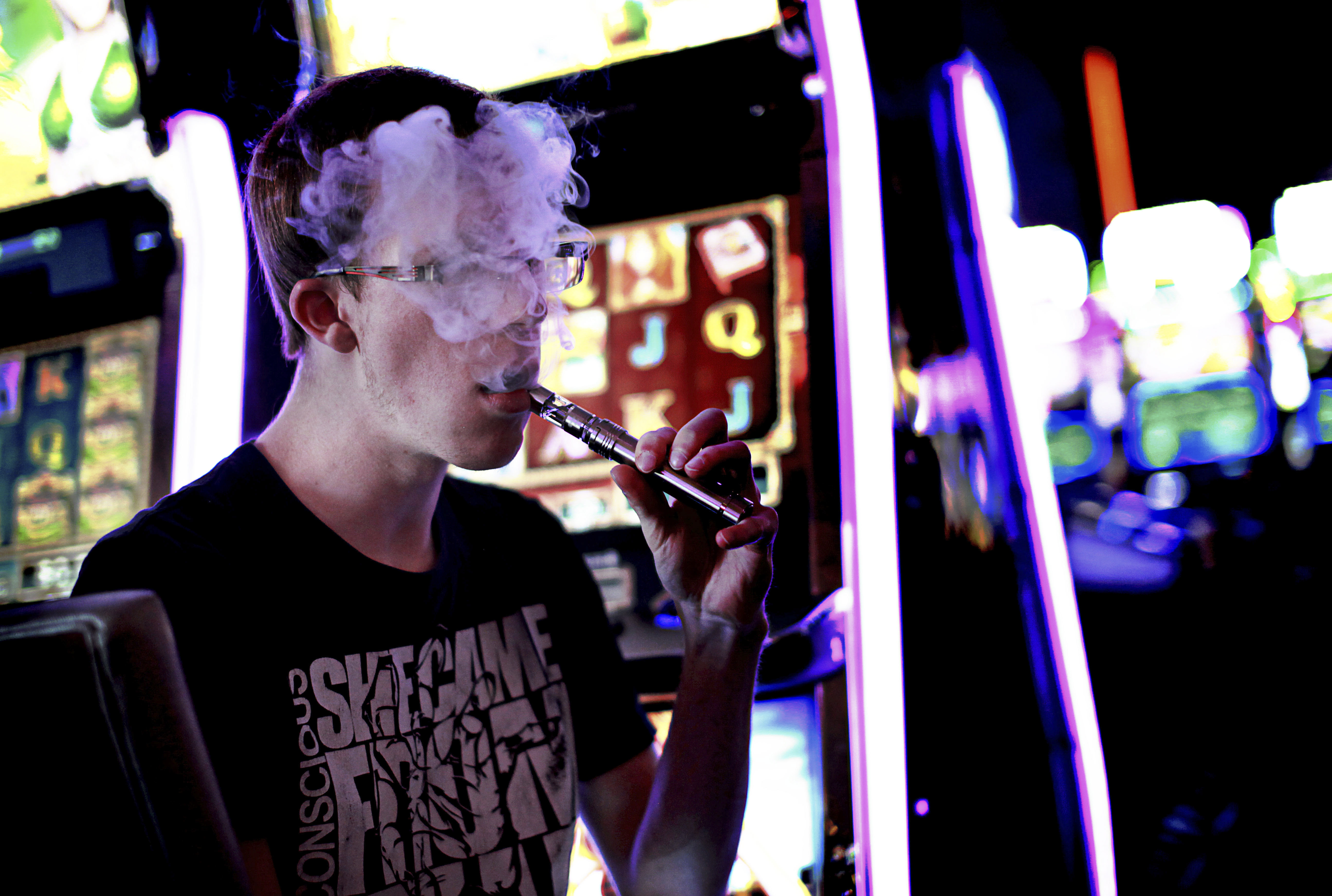 A casino patron exhales vapor from an e-cigarette, in Las Vegas, May 1, 2014. A study to be published this month in Nicotine and Tobacco Research suggests that e-cigarettes can get hot enough to produce the same carcinogens as cigarettes, undercutting health claims and underscoring the uncertainties in a rapidly-evolving  industry that regulators are struggling to keep pace with. (Sandy Huffaker/The New York Times)