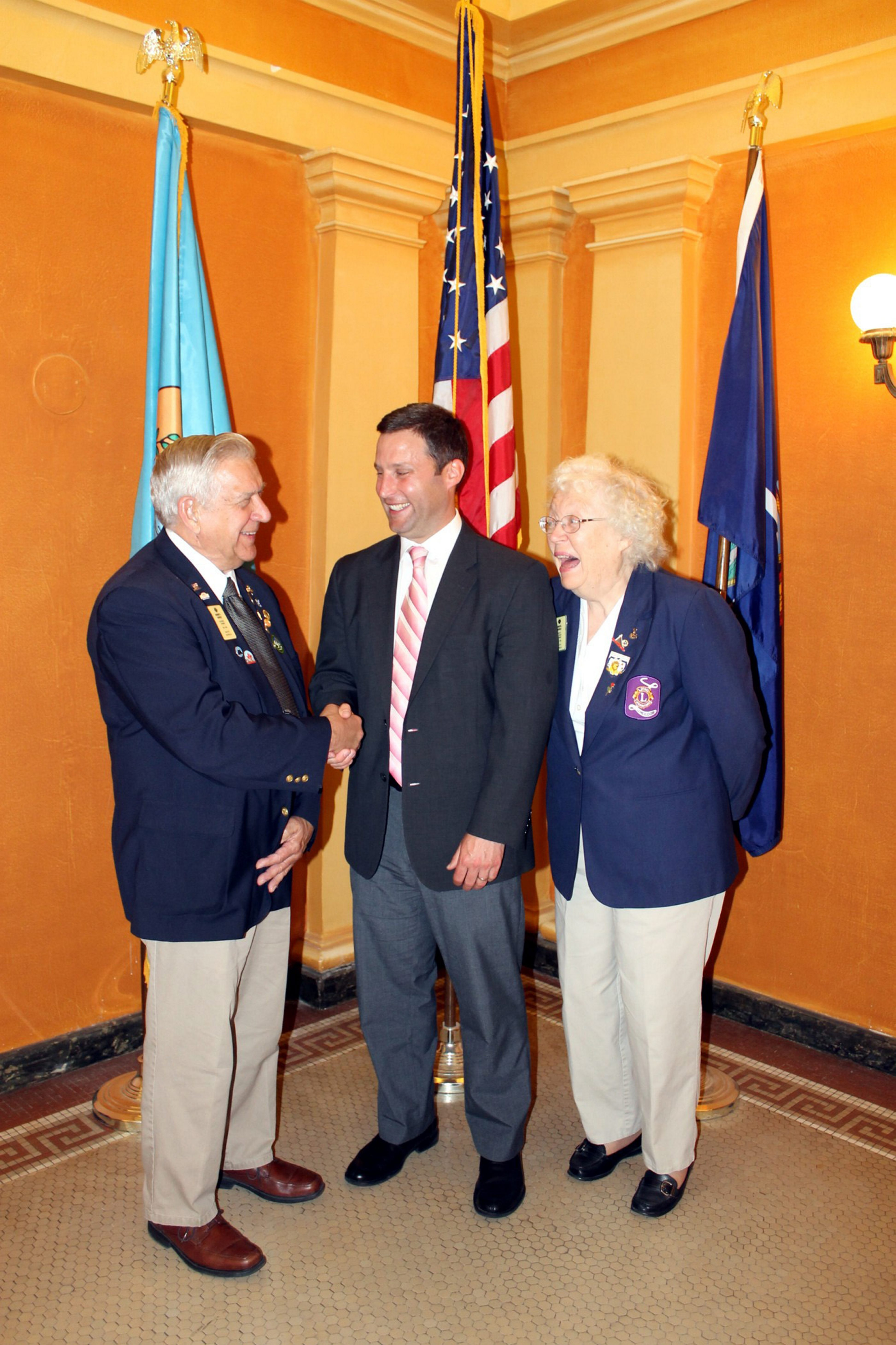 From left, Senior Citizen of the Year award recipient Robert Shively; Kenneth M. Genewick, county director of the Office for the Aging;  and Shively's wife, Joan.
