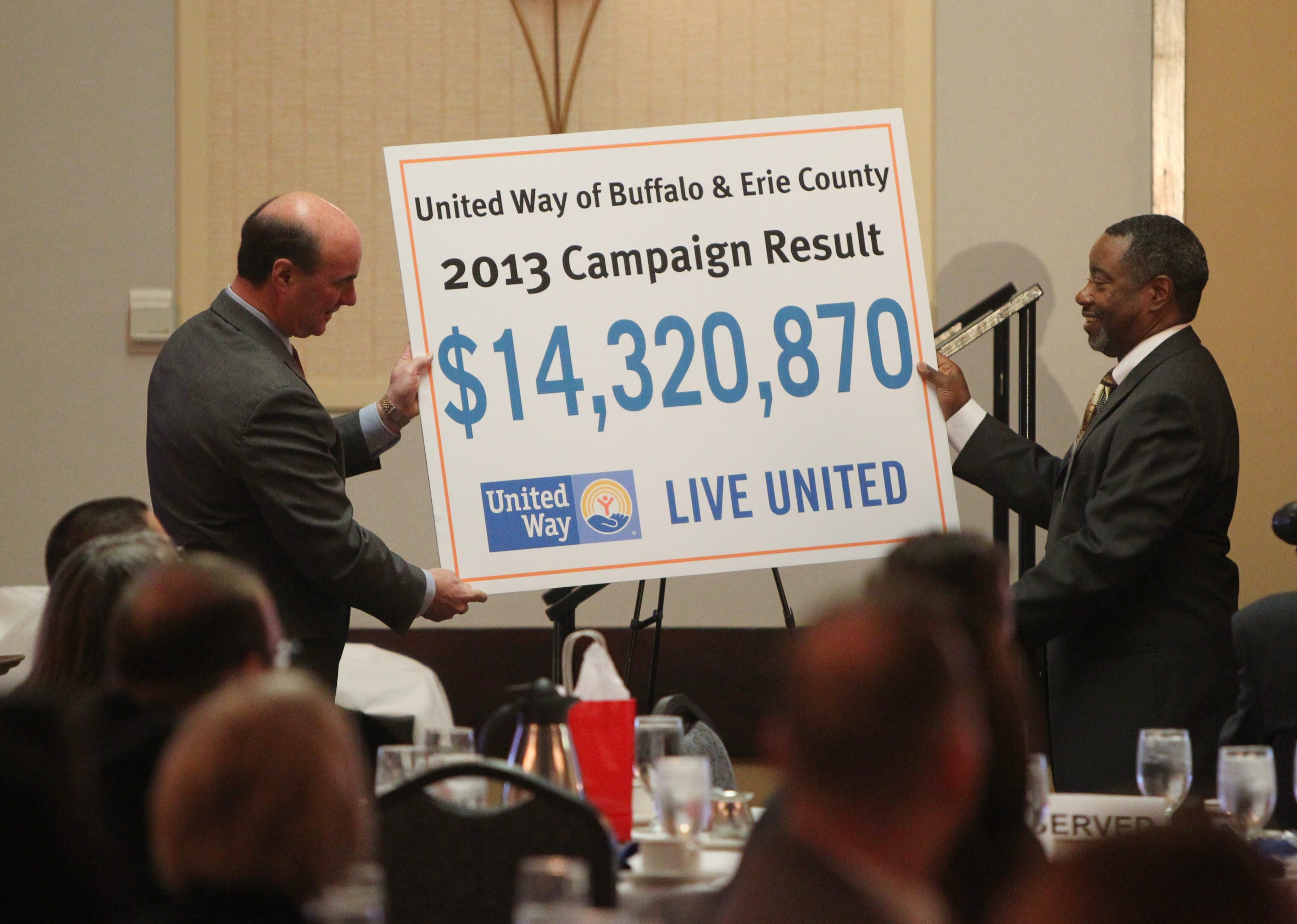 United Way of Buffalo and Erie Co. CEO Michael Weiner, left, and Steve Finch, chairman of the United Way of Buffalo and Erie County board, right, at the Hyatt in Buffalo on April 11.