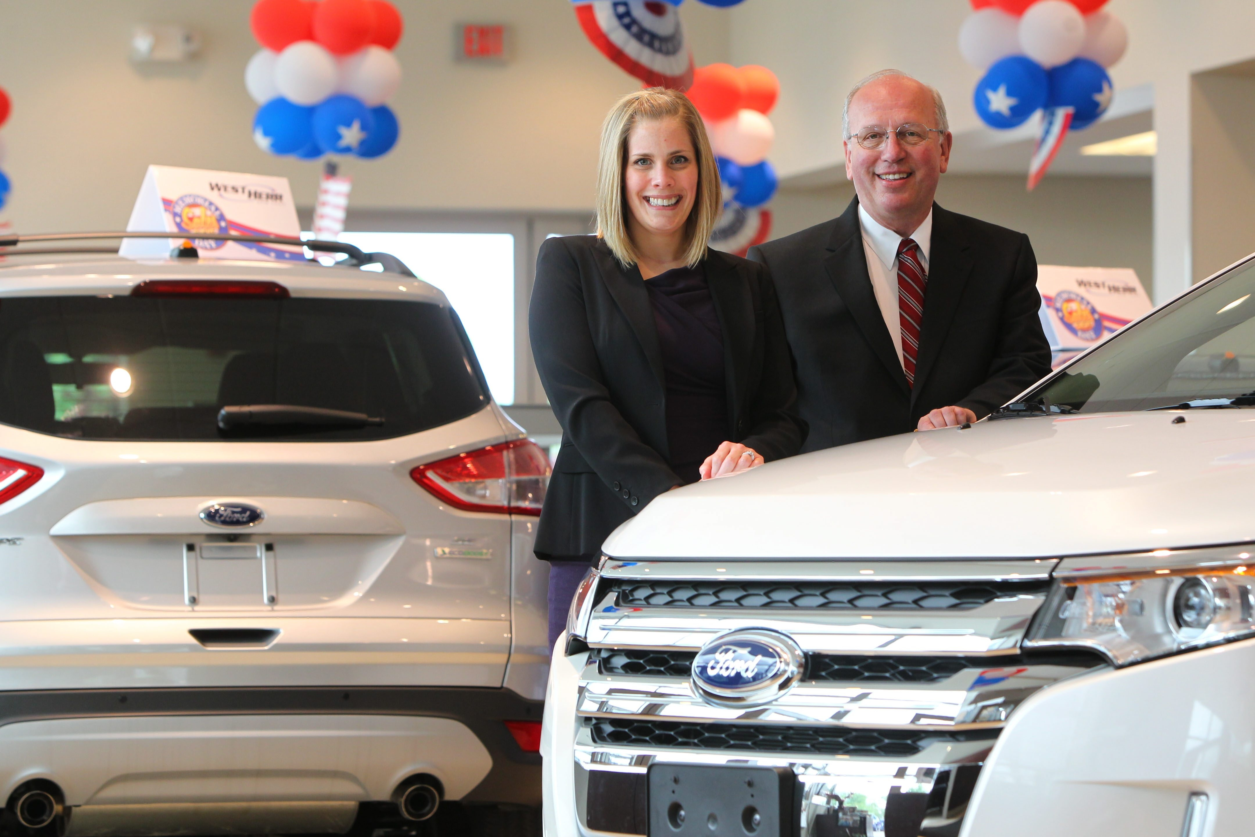 West Herr Ford/Lincoln of Amherst General Manager Beth Hollis and President and CEO Scott Bieler at the dealership in Getzville.