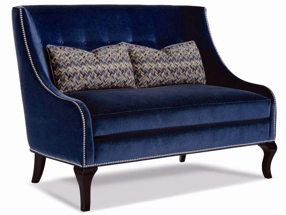 A Raina settee by Taylor King is tailored in velvet with matching buttons.